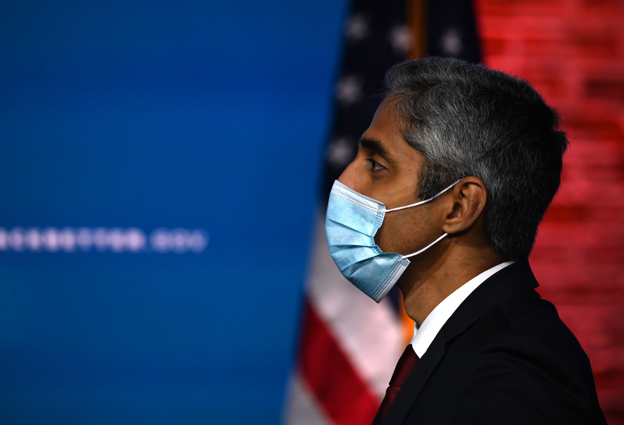 Dr. Vivek Murthy looks on as Joe Biden speaks at The Queen in Wilmington, Delaware, on December 8, 2020.