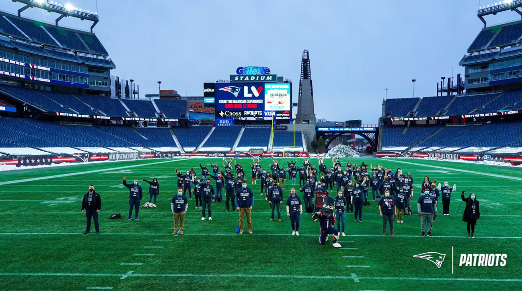 The Patriots posted this photo on Sunday morning of the 76 Super Bowl-bound vaccinated health care workers.