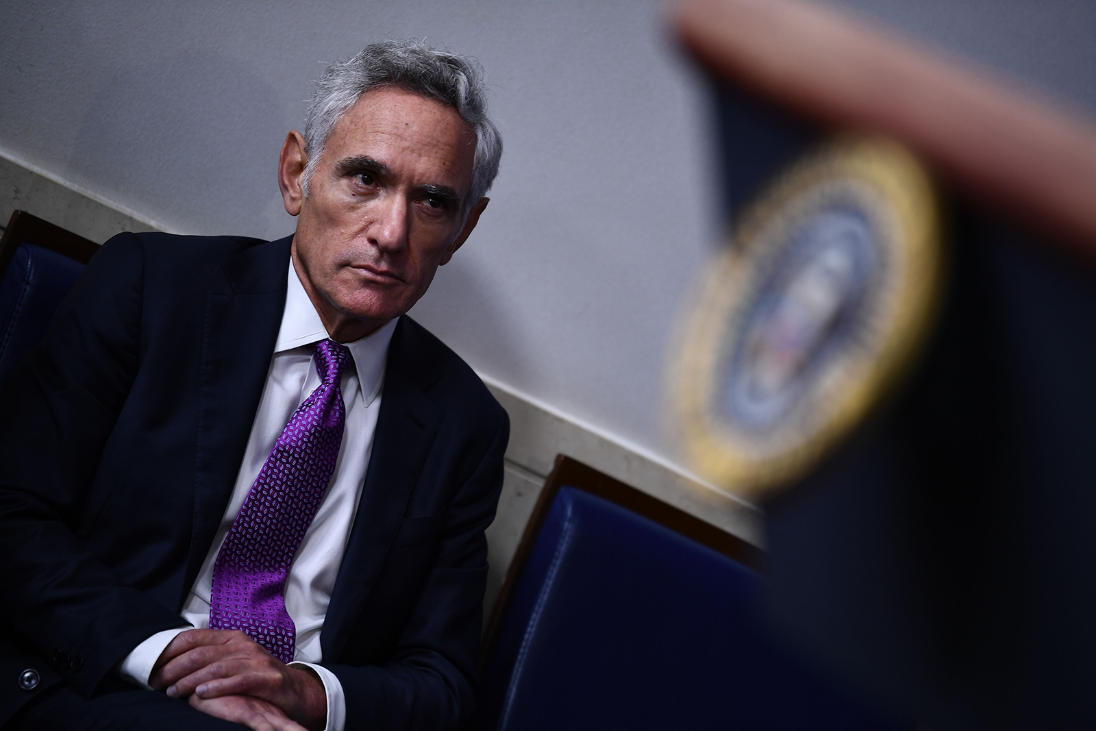 Member of the coronavirus task force Dr. Scott Atlas listens to US President Donald Trump during a briefing at the White House in Washington, DC on August 10.