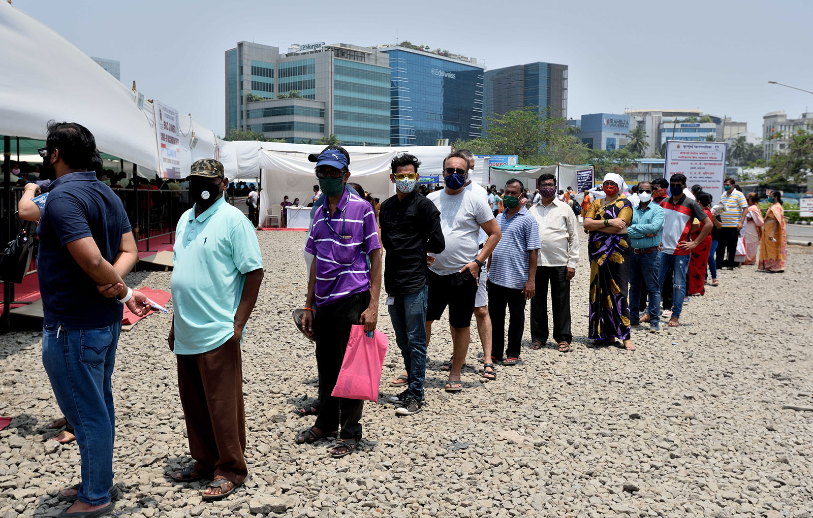 People wait in line to get vaccinated in Mumbai on April 27.