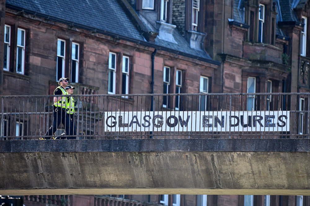 Two police officers walk past a sign at Charing Cross on May 6 in Glasgow, Scotland.