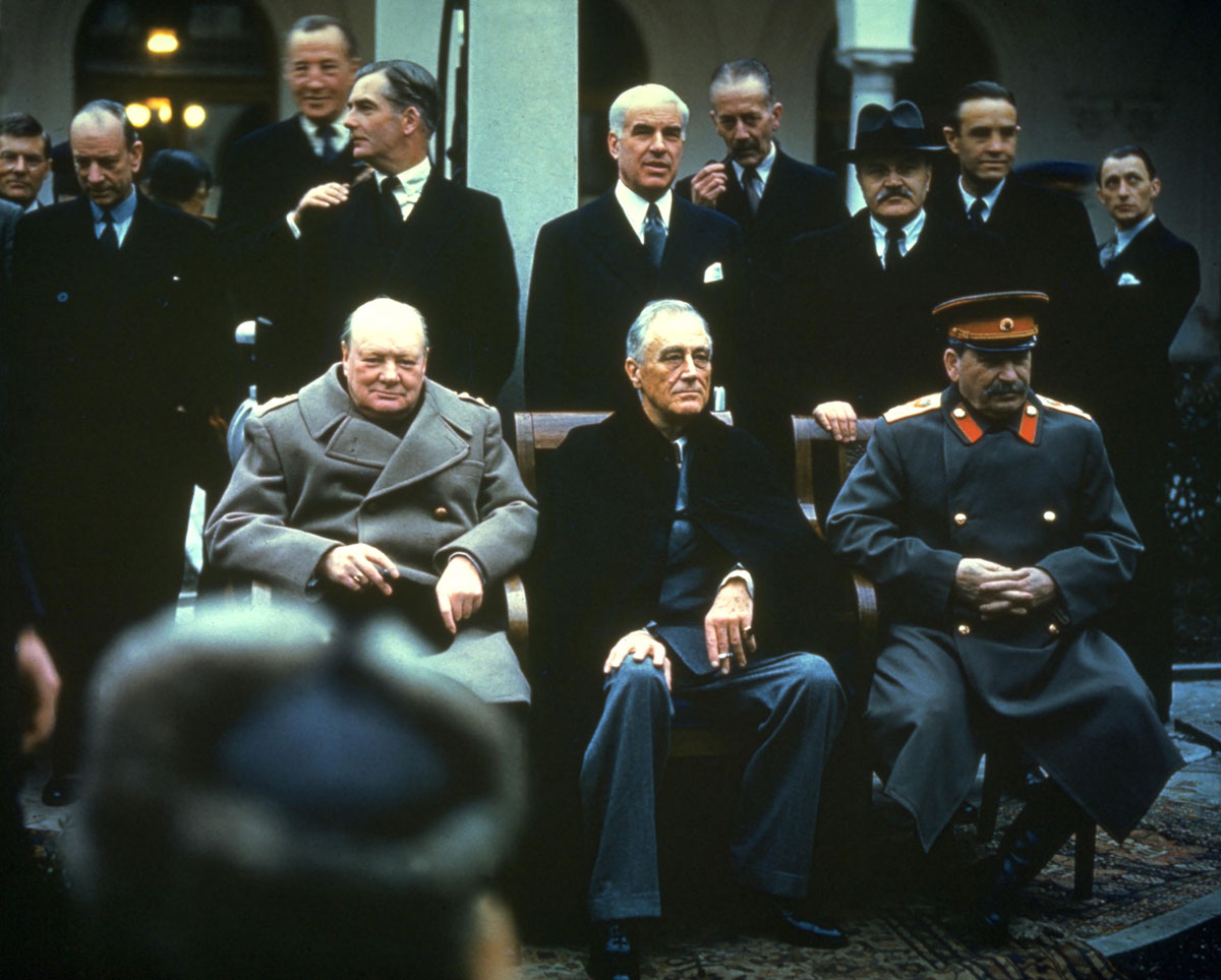"""From left, Churchill, Roosevelt and Stalin attend the Yalta Conference in the Soviet Union in 1945. They were meeting to talk about a postwar plan for Europe and how it would be reorganized after the fall of Nazi Germany. Today,many historians conclude that Stalin was the """"winner"""" at Yalta,as much of Eastern Europe would soon fall within the Soviet orbit. Churchill and Roosevelt won no meaningful concessions on Poland, which was already occupied by Soviet troops."""