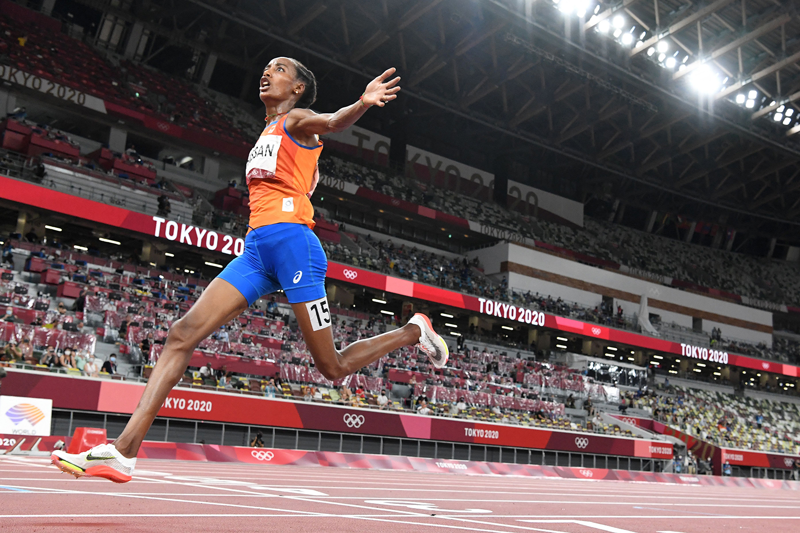 Netherlands' Sifan Hassan celebrates as she wins the women's 10,000m final during the Tokyo 2020 Olympic Games at the Olympic Stadium in Tokyo on August 7.