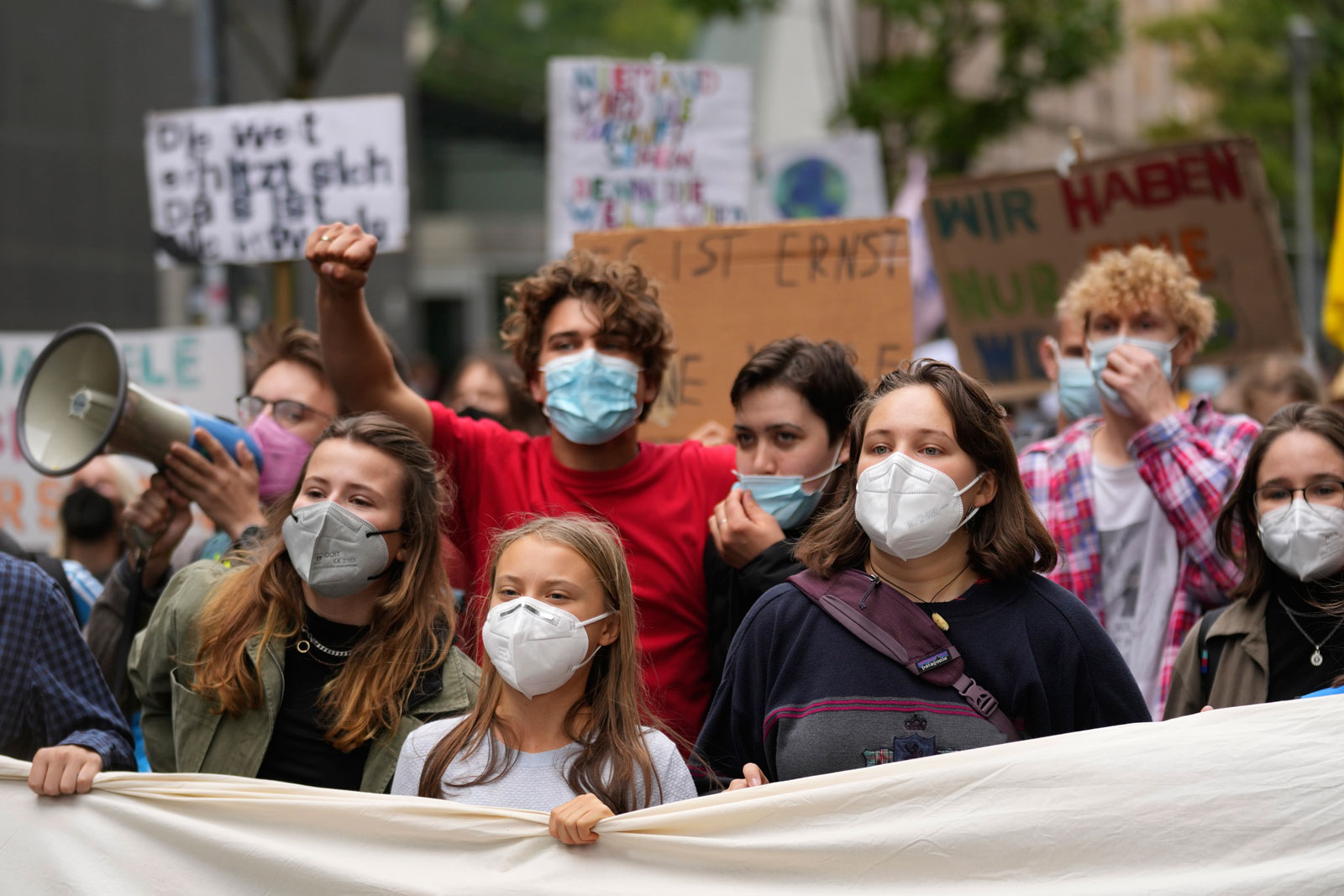 Swedish climate activist Greta Thunberg, center, joins a Fridays for Future global climate strike in Berlin, Germany on Friday, September 24.