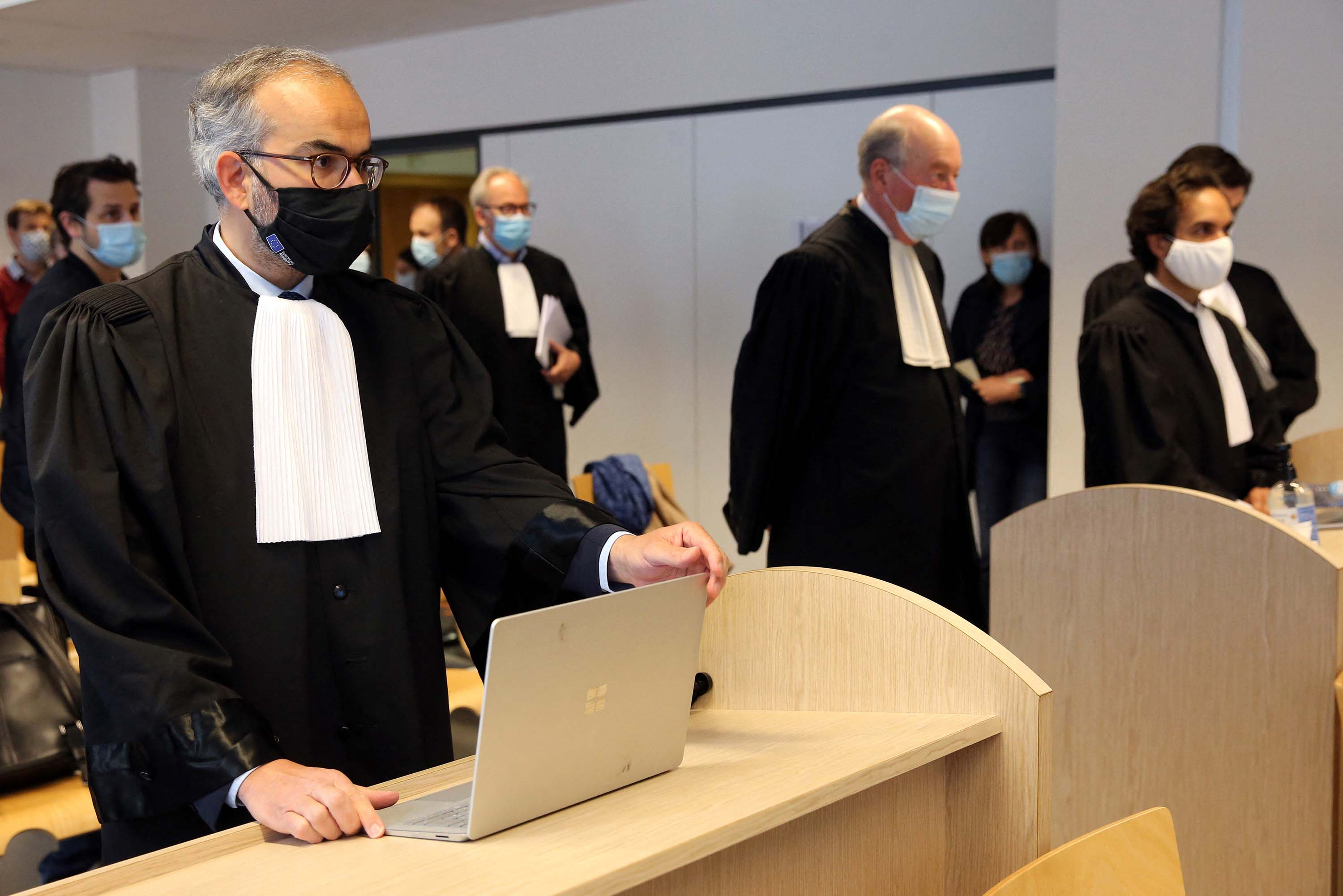 Hakim Boularbah, lawyer for the Swedish-British AstraZeneca pharmaceutical company, left, and lawyers of the European Commission attend the hearing concerning the legal action by the European Commission against AstraZeneca at a Brussels courthouse, on April 28.