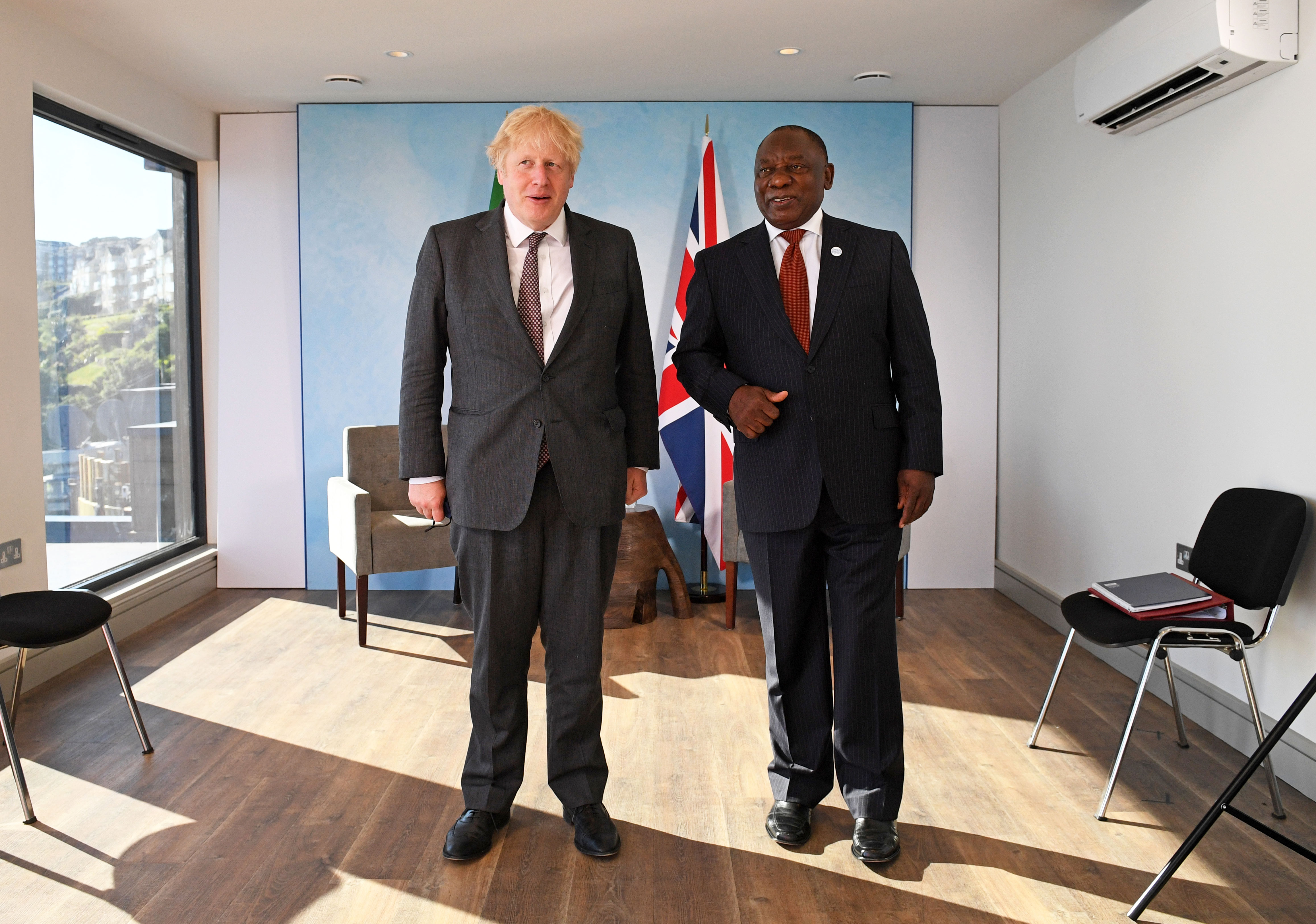 UK Prime Minister Boris Johnson and South African President Cyril Ramaphosa pose for a photo ahead of a bilateral meeting in Carbis Bay, England, on June 13.