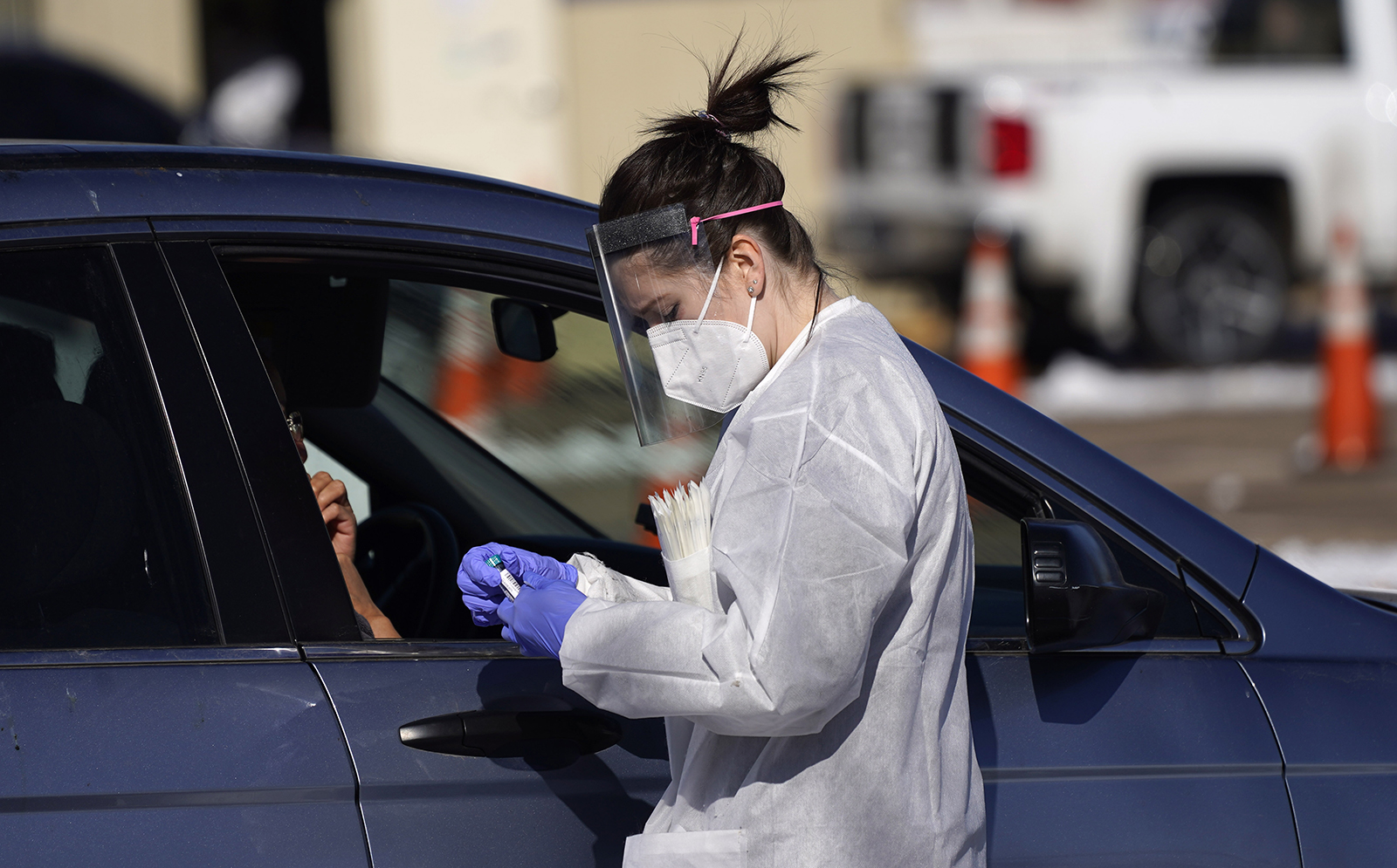 In this Oct. 27, 2020, file photo, a tester prepares to administer a swab test at a drive-in Covid-19 testing site in Federal Heights, Colorado.