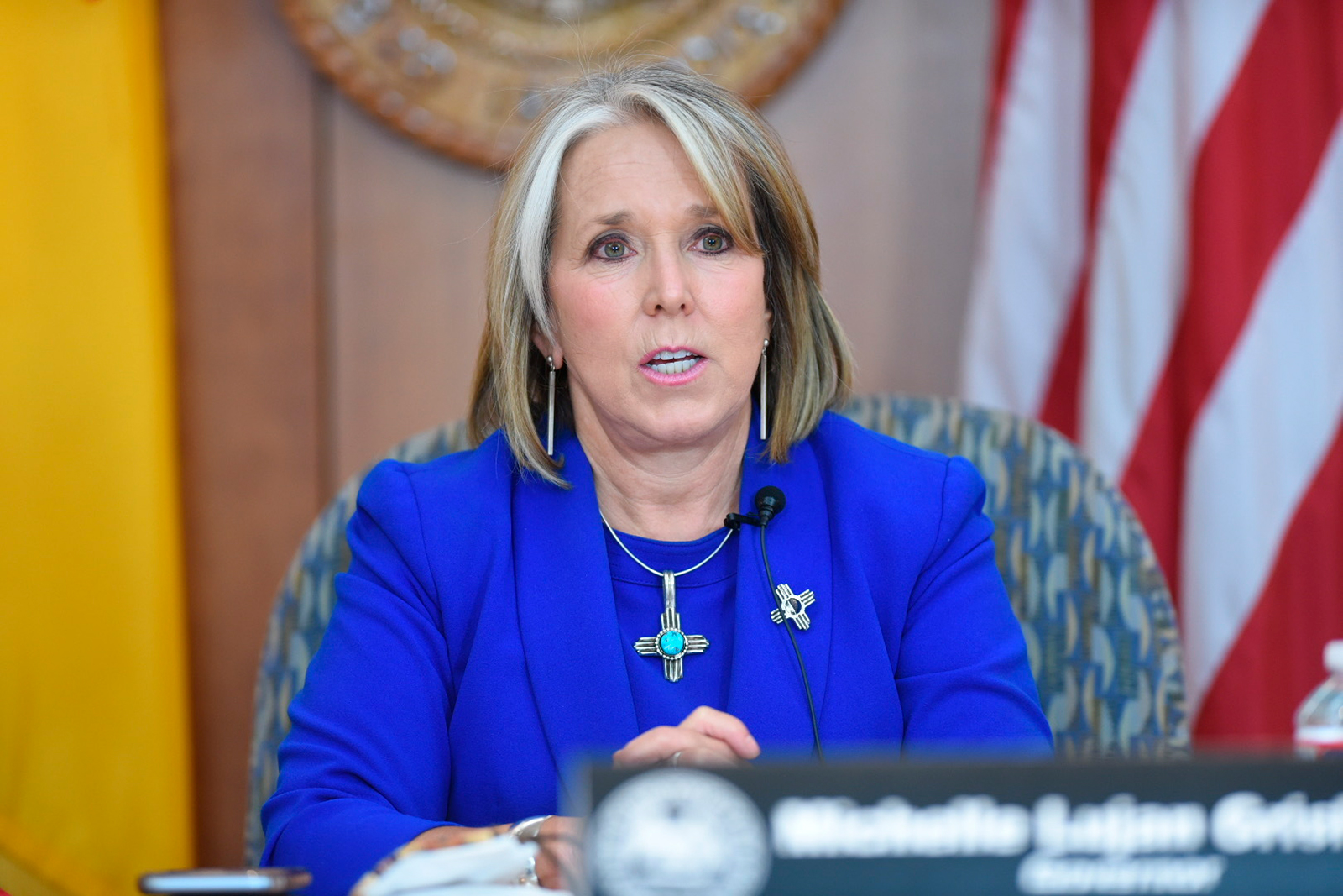 New Mexico Gov. Michelle Lujan Grisham speaks about the uptick in confirmed Covid-19 cases in the state and her decision to hold off on opening more of the economy during a news conference at the state Capitol in Sante Fe on Thursday, June 25.