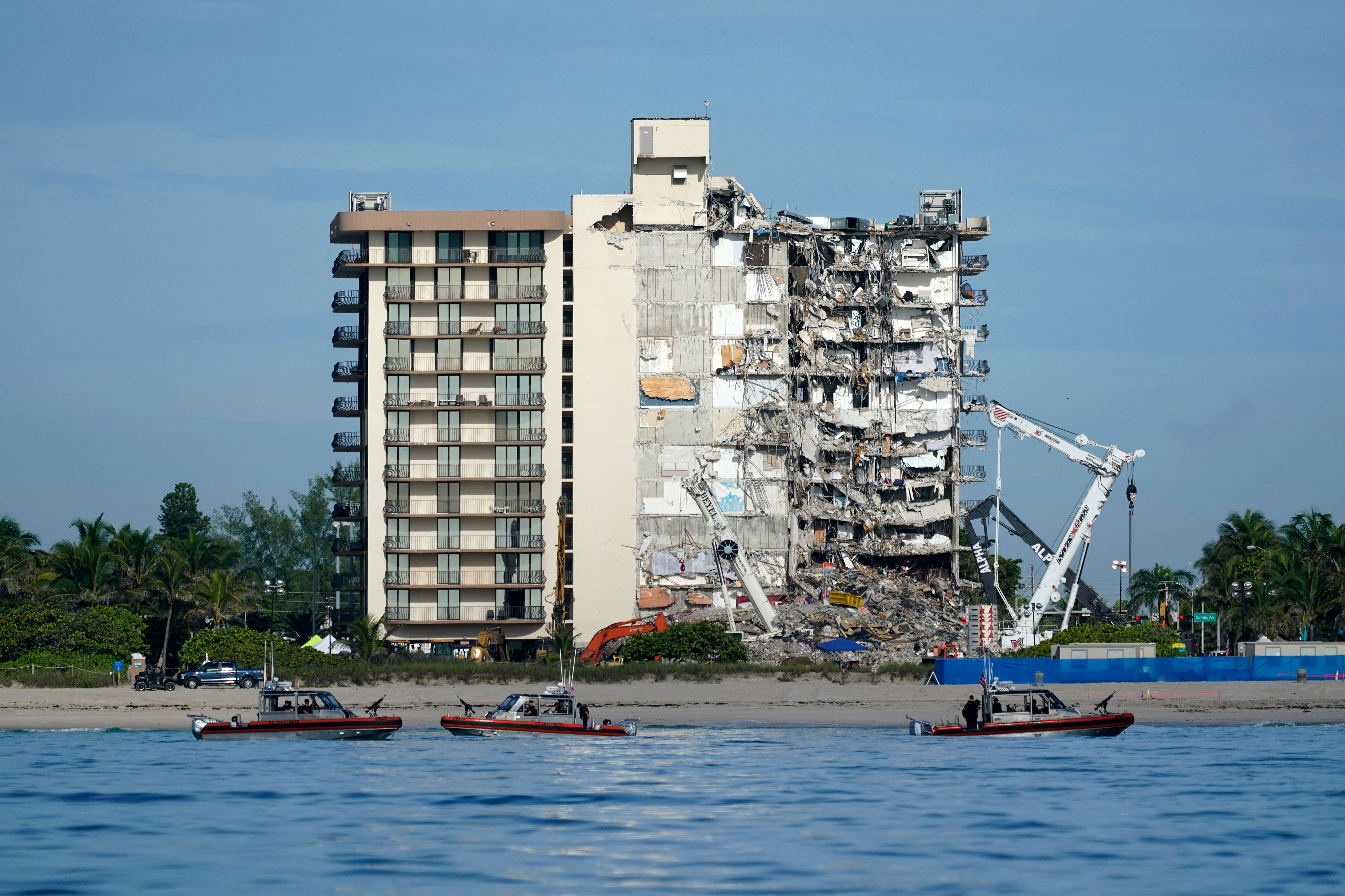US Coast Guard boats patrol in front of the partially collapsed Champlain Towers South building in Surfside, Florida, on July 1, 2021.