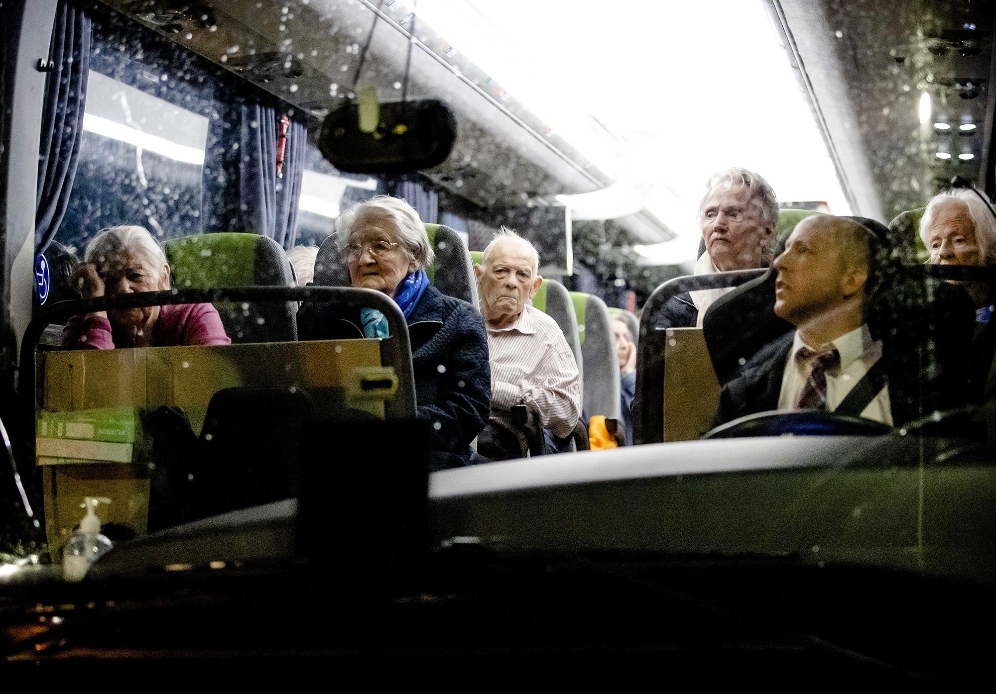 Evacuees ride a bus in Valkenburg aan de Geul, Netherlands.