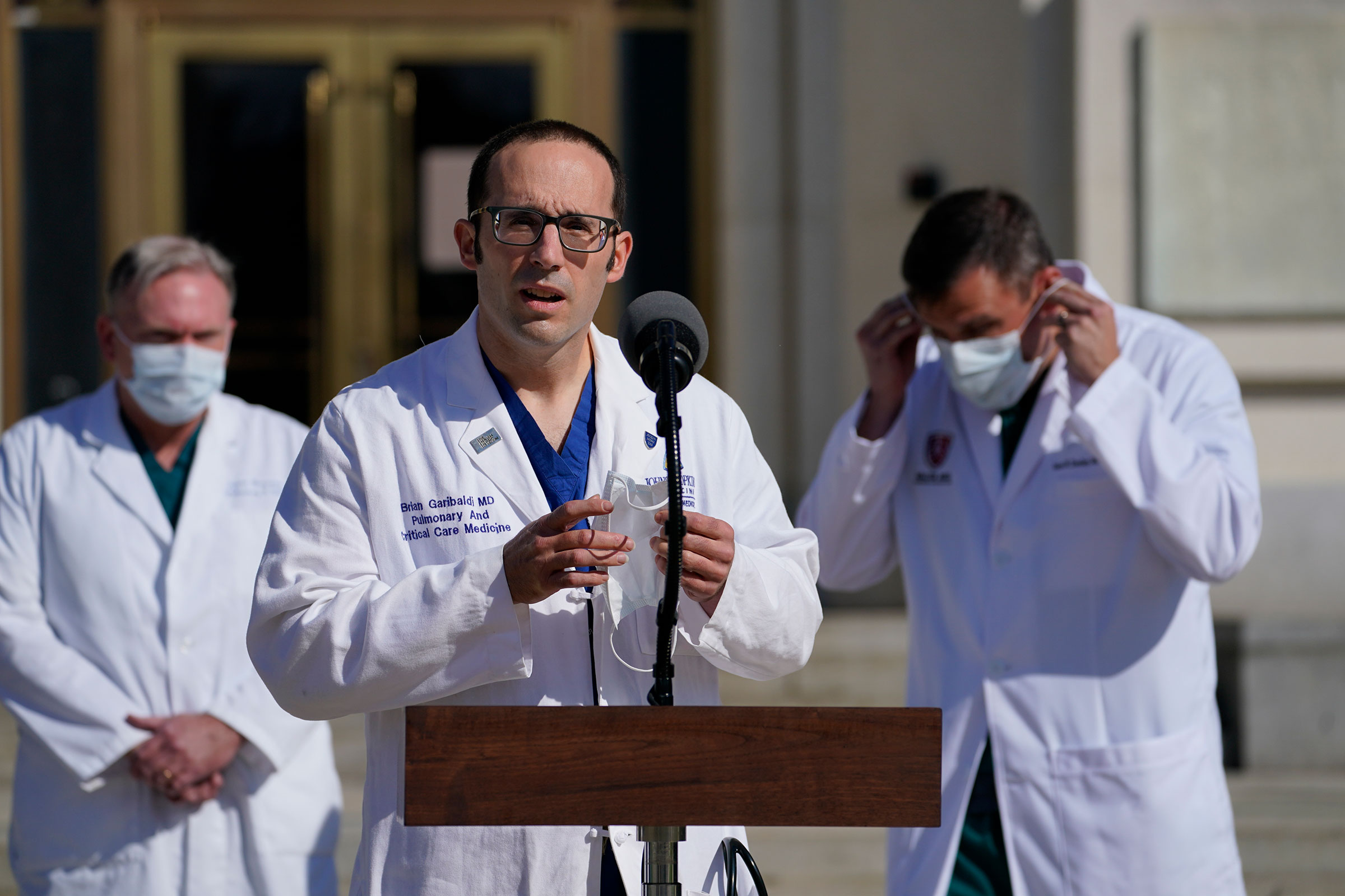 Dr. Brian Garibaldi, talks with reporters at Walter Reed National Military Medical Center on October 5 in Bethesda, Maryland