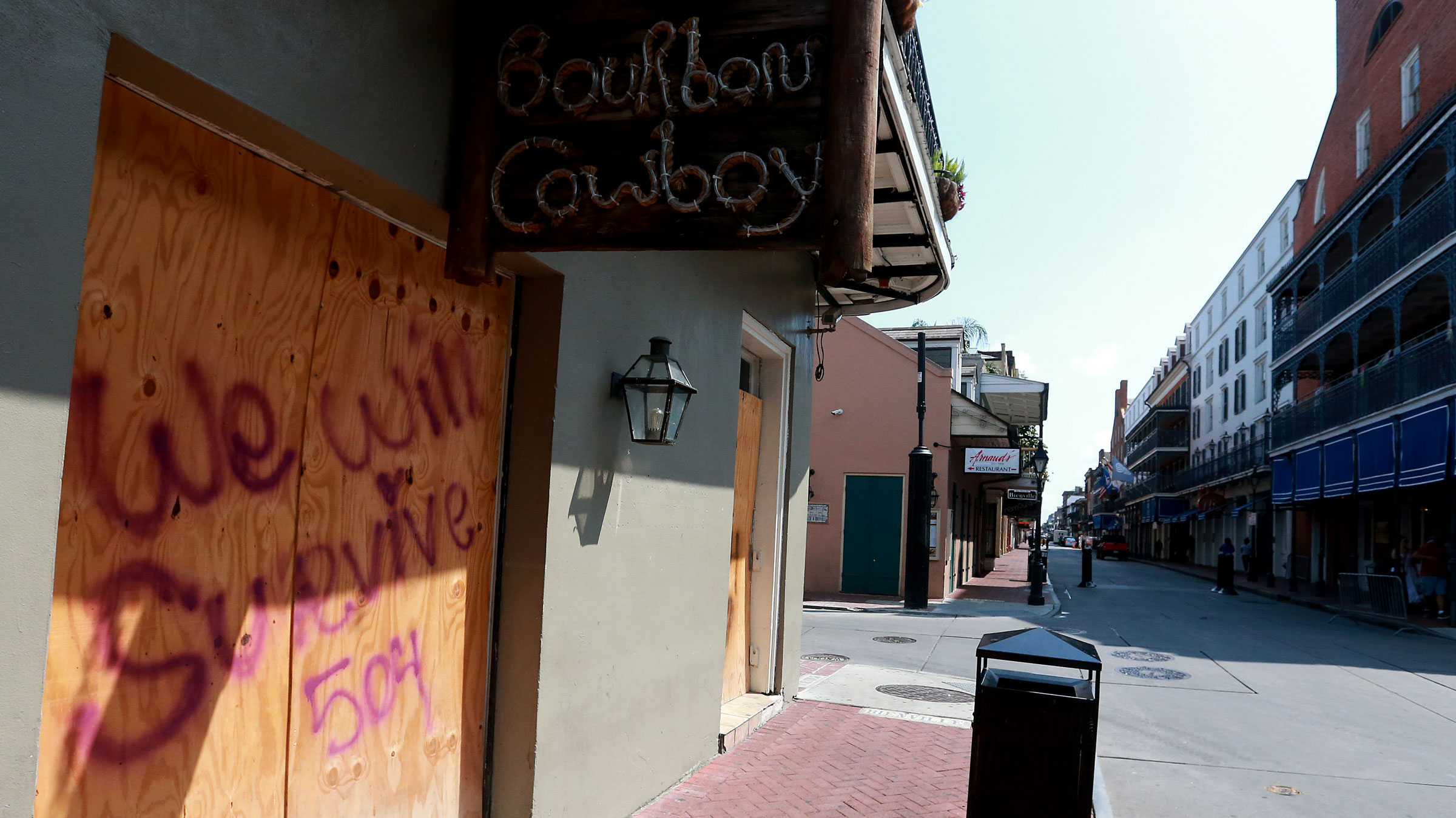 The Bourbon Cowboy bar is boarded up in New Orleans' French Quarter on Tuesday.