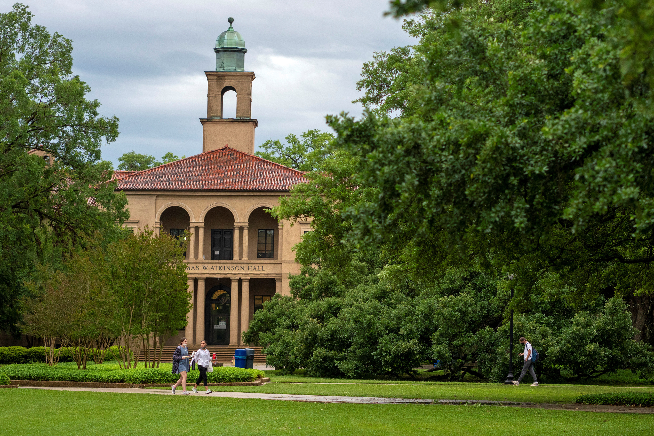 Students walk at the Louisiana State University campus in Baton Rouge, Louisiana, in April 2021.