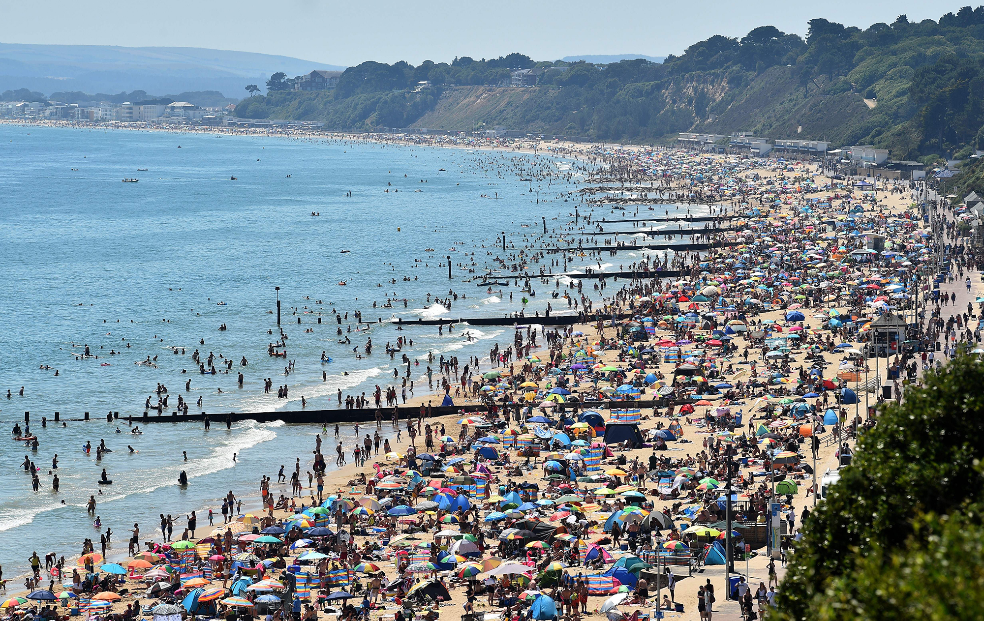 Crowds on the beach in Bournemouth, southern England, on June 25, 2020.