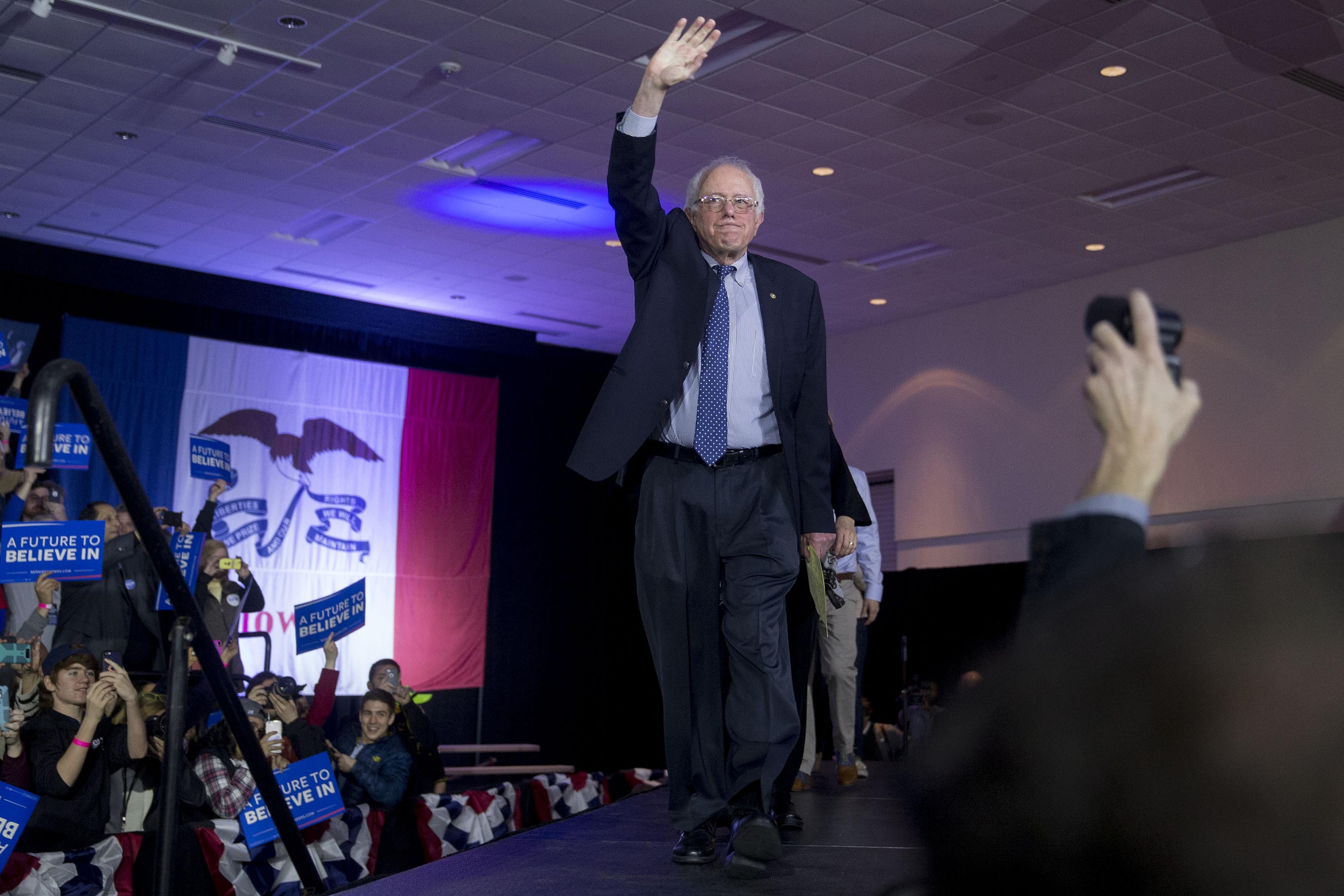 In this February 2016 photo, Sen. Bernie Sanders waves as he arrives to speak during a caucus night party in Des Moines, Iowa.