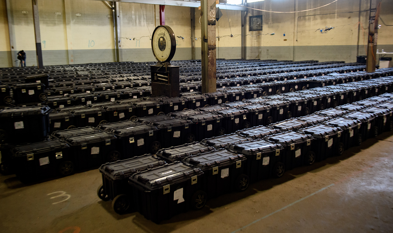 Election precinct suitcases containing ballots, election materials and keys to voting machines are held under guard by the Allegheny County Police at the Allegheny County elections warehouse in Pittsburgh, Pennsylvania, on November 4.