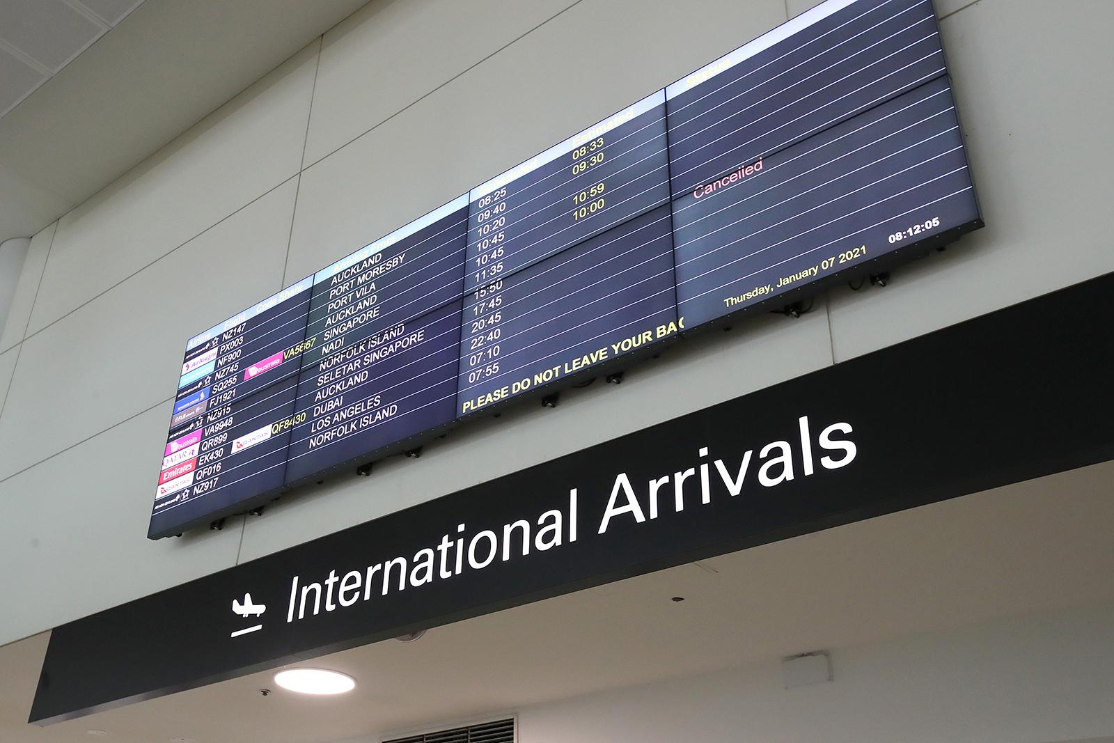 A digital screen displays flight arrival times at Brisbane Airport on January 7, in Brisbane, Australia.