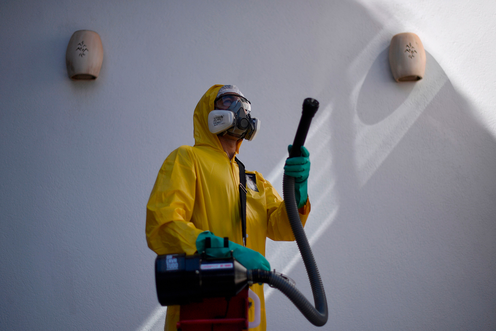 An employee of a private company sanitizes against the spread of Covid-19 at a house in Belo Horizonte, Brazil, on June 26.