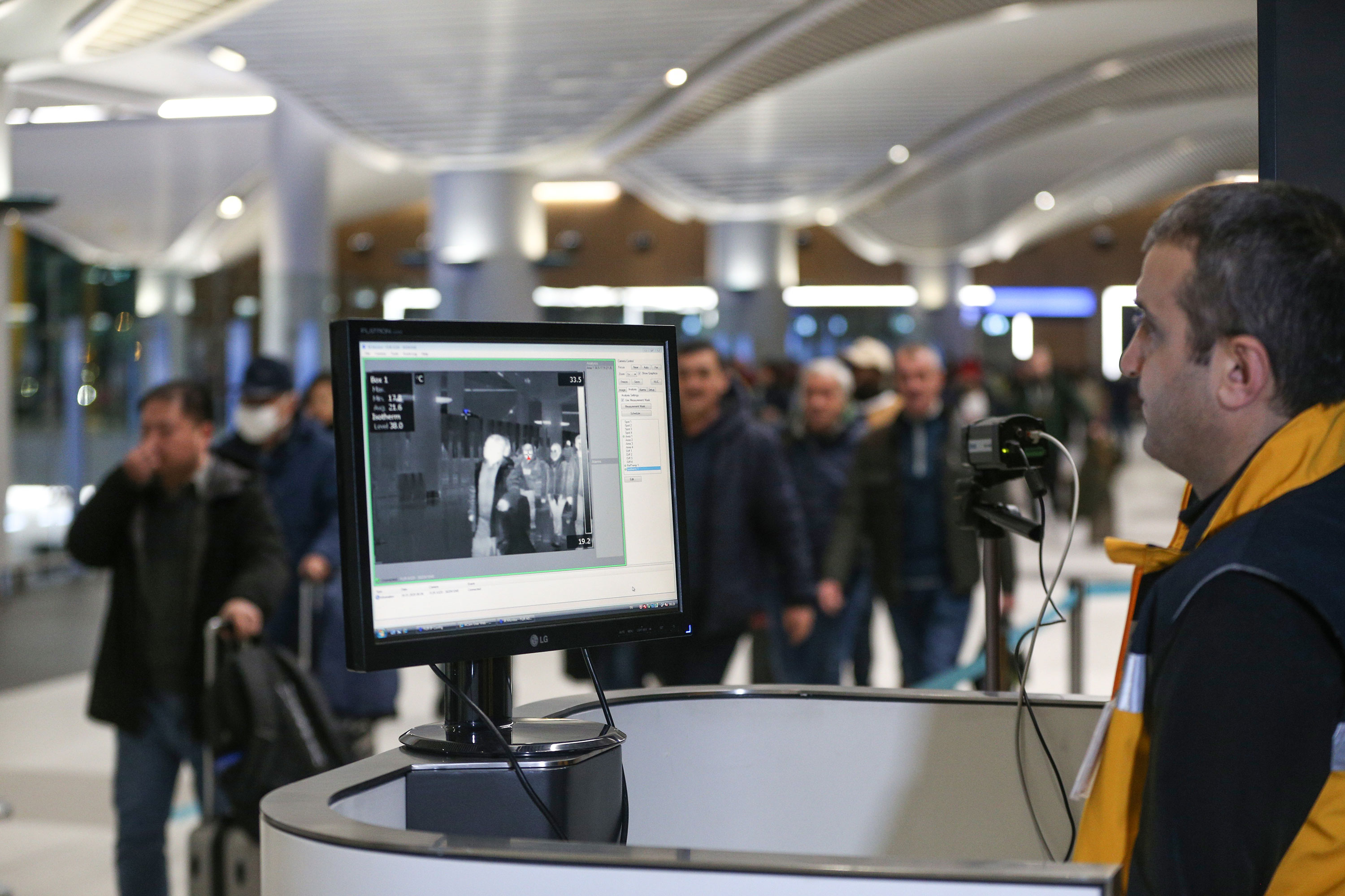 Passengers walk through a thermal scanner upon their arrival at Istanbul Airport, Turkey on January 24.