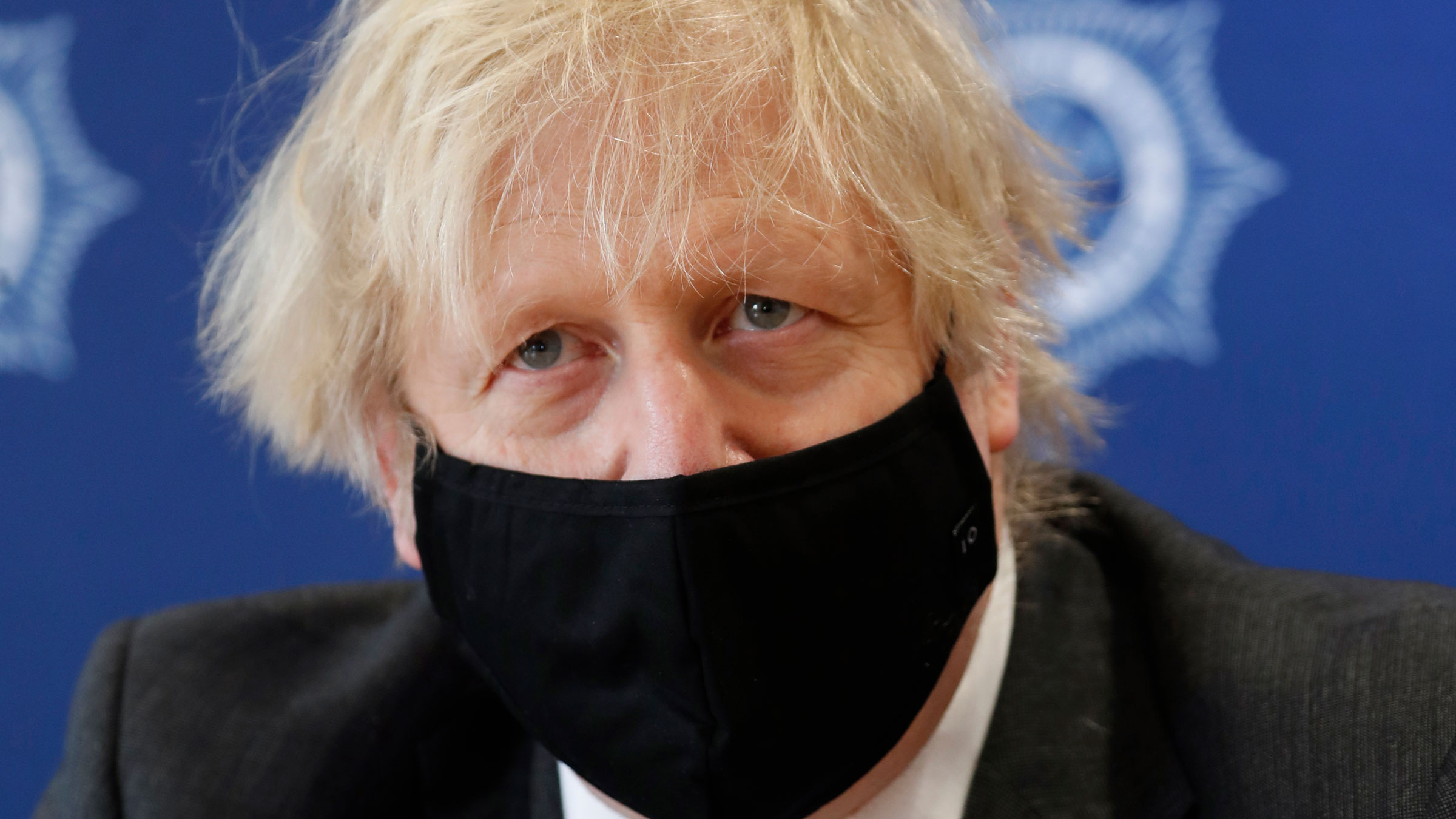 British Prime Minister Boris Johnson visits the South Wales Police Headquarters in Bridgend, Wales, on Wednesday.