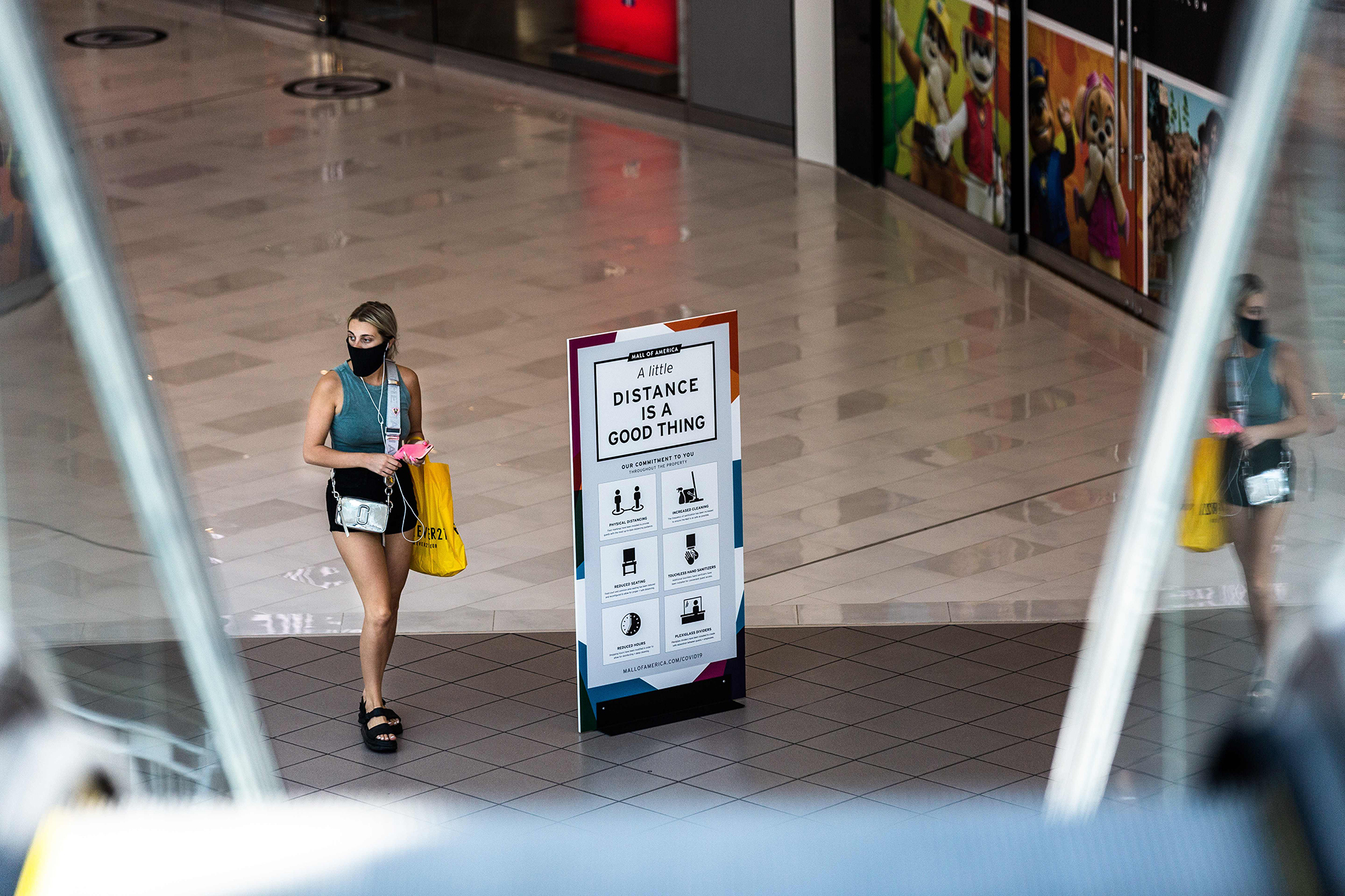 A shopper wearing a face mask walks through the Mall of America on June 16, 2020 in Bloomington, Minnesota, after some of the shops at the mall reopened on June 10.