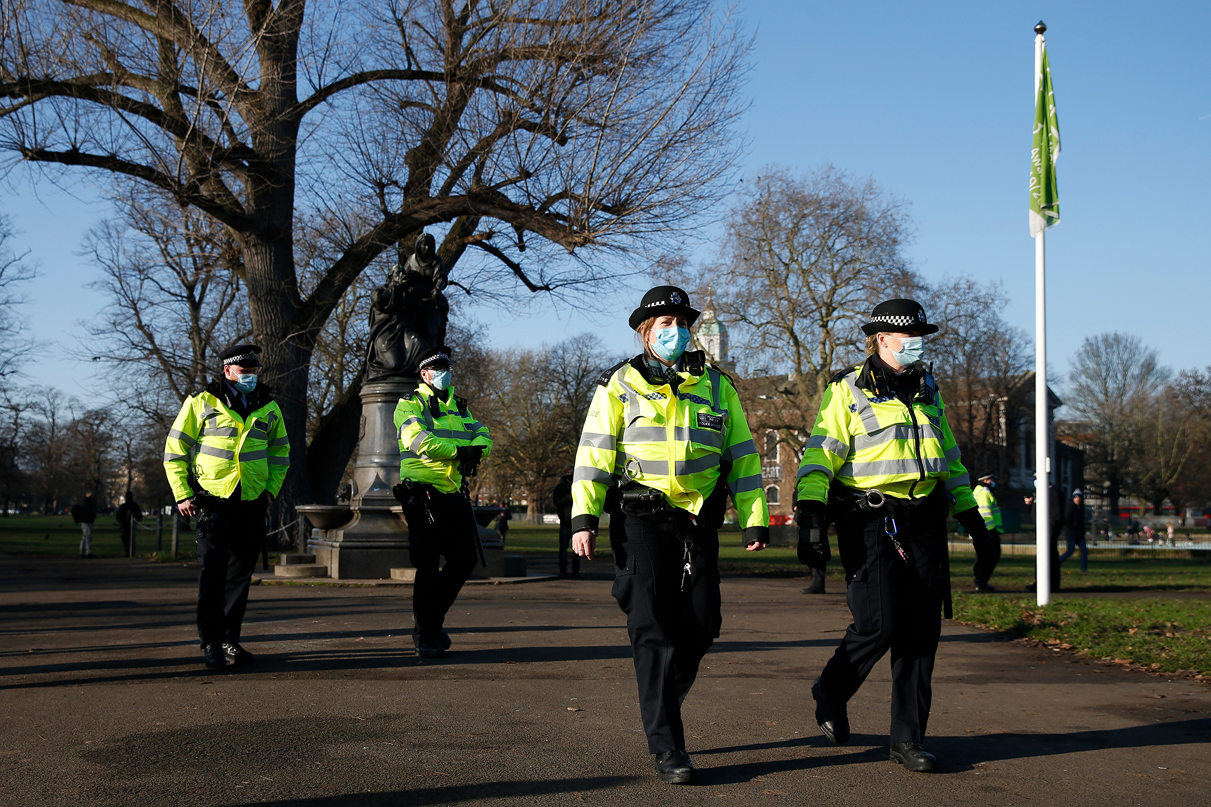 Police patrol Clapham Common for people not complying with coronavirus safety protocols on January 9 in London.