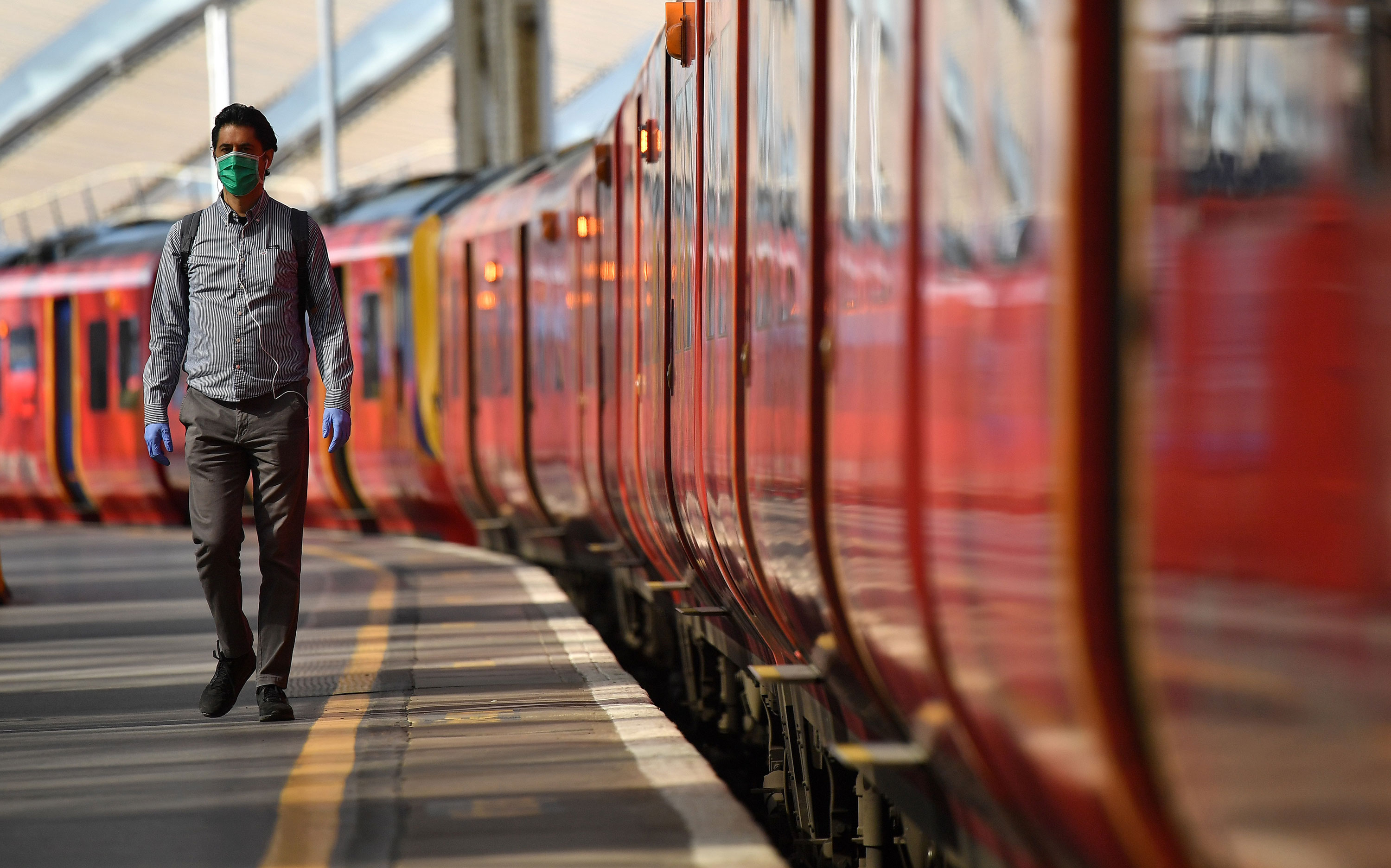 A passenger walks along a platform after arriving at Waterloo Train station in central London on May 18.