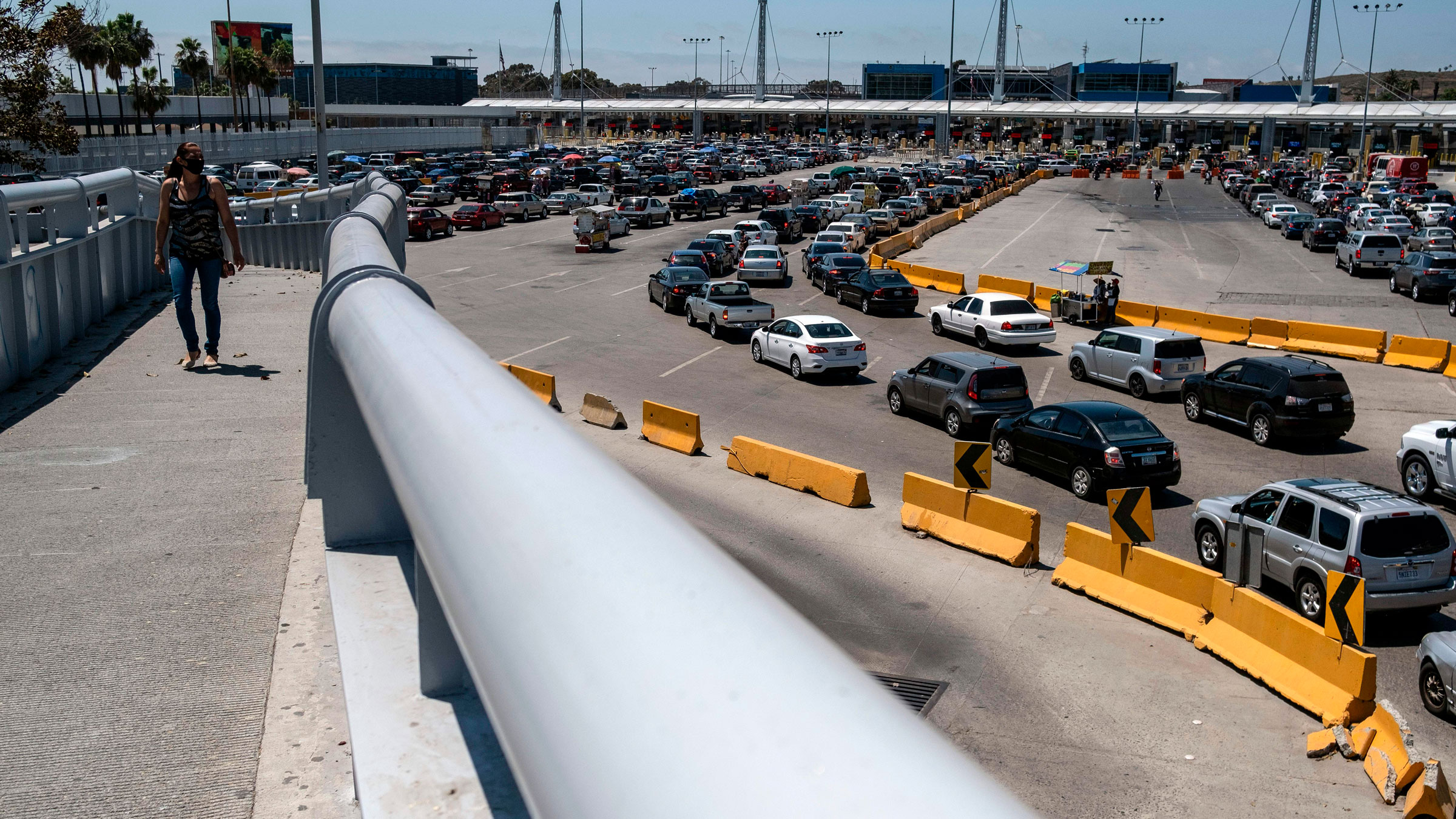 Commuters line up June 16 at the San Ysidro crossing port in Tijuana, Mexico.