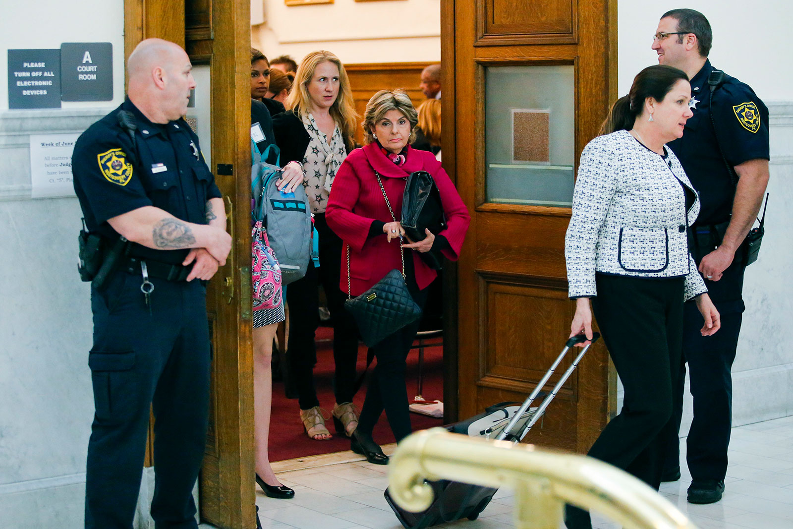 Attorney Gloria Allred, center, walks out of the courtroom at Montgomery County courthouse during Bill Cosby's trial in 2017.