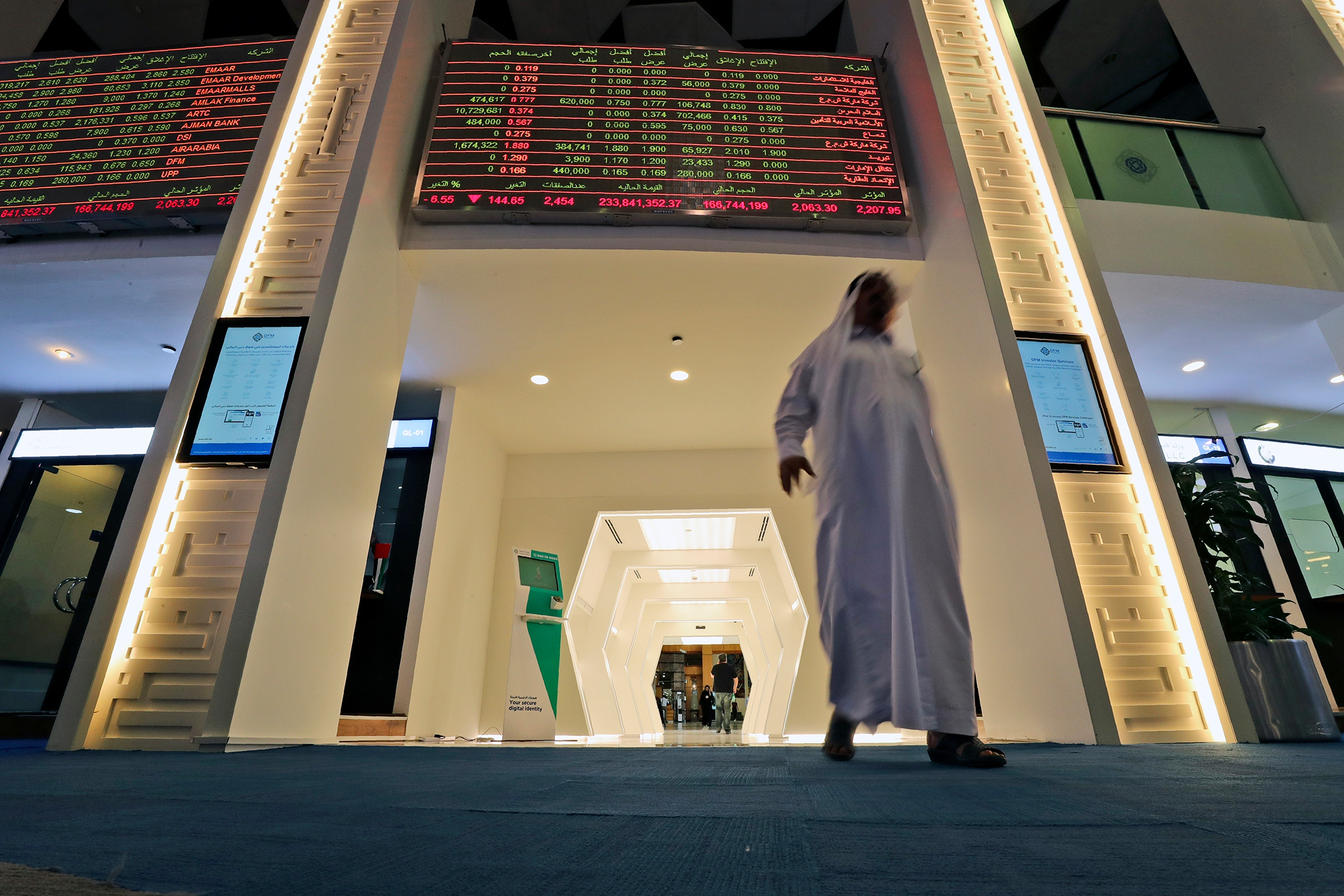 A trader arrives at the Dubai Financial Market in Dubai, United Arab Emirates, Thursday, March 12.
