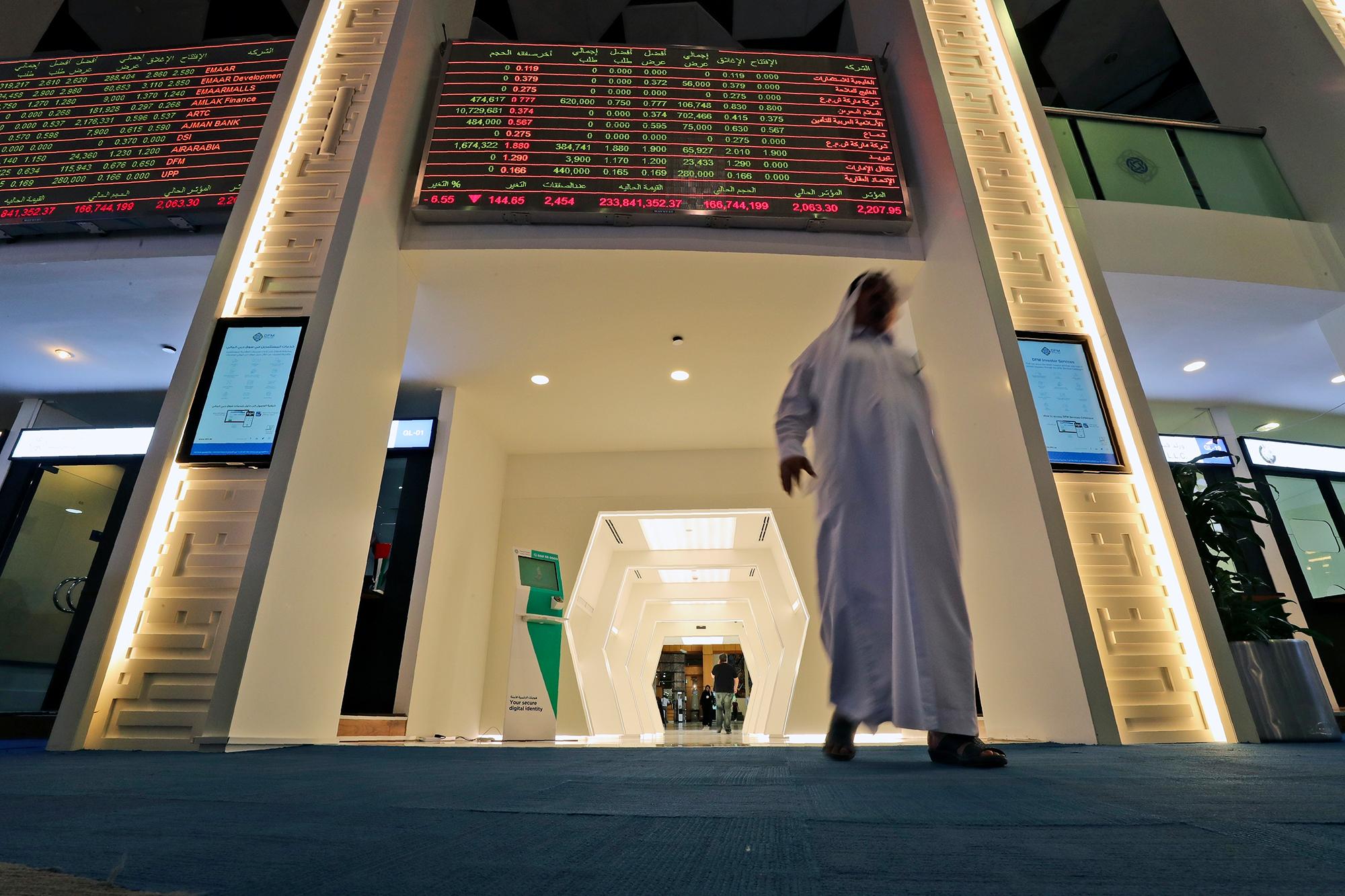 A trader arrives at the Dubai Financial Market in Dubai, United Arab Emirates, Thursday, March 12.