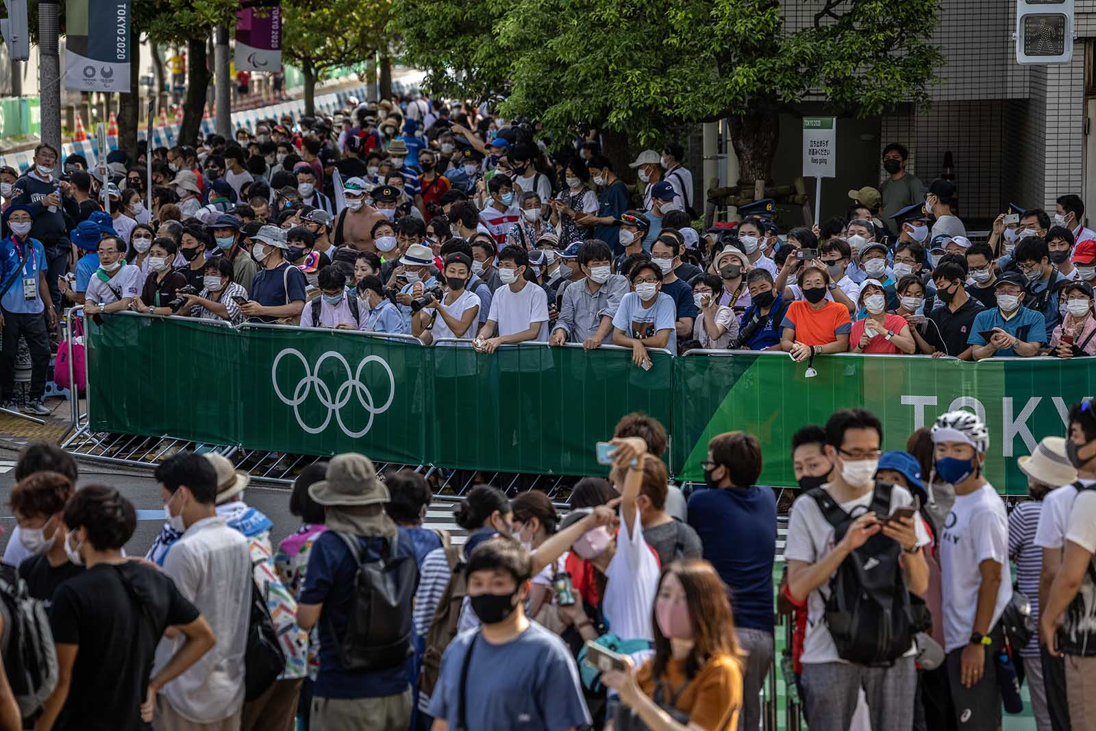 Spectators gather to watch the triathlon relay on Saturday, July 31, in Tokyo.
