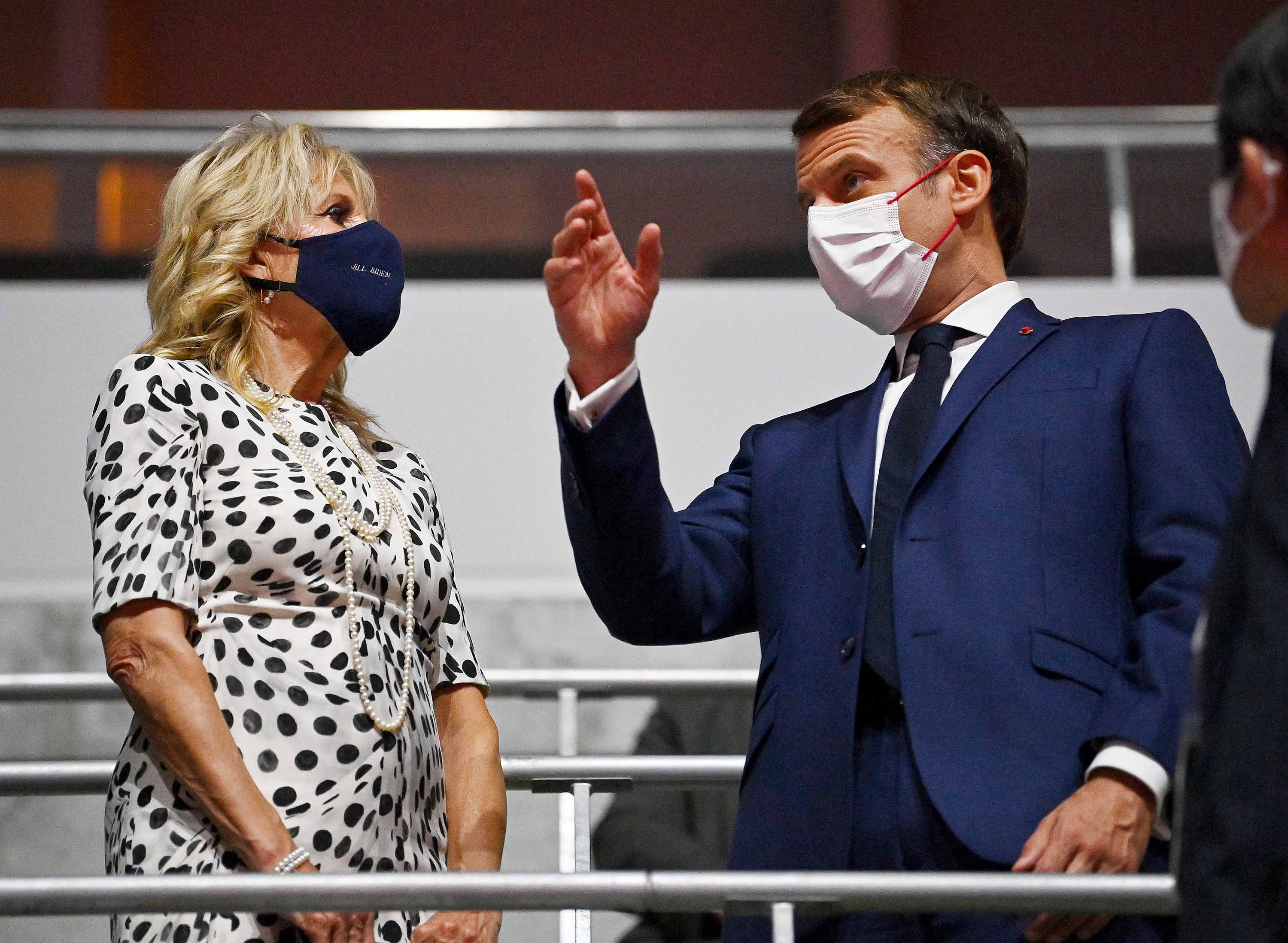 U.S. First Lady, Jill Biden talks with French President Emmanuel Macron ahead of the Opening Ceremony.
