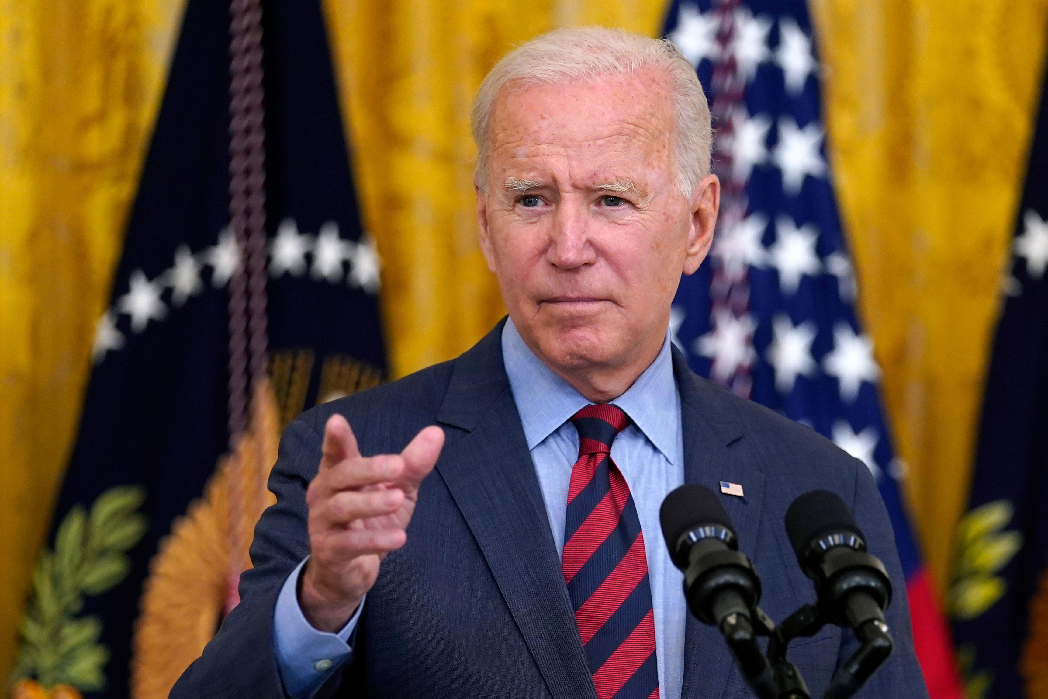 President Joe Biden gestures to a reporter to ask him a question as he speaks about the coronavirus pandemic in the East Room of the White House on, Tuesday, August 3.