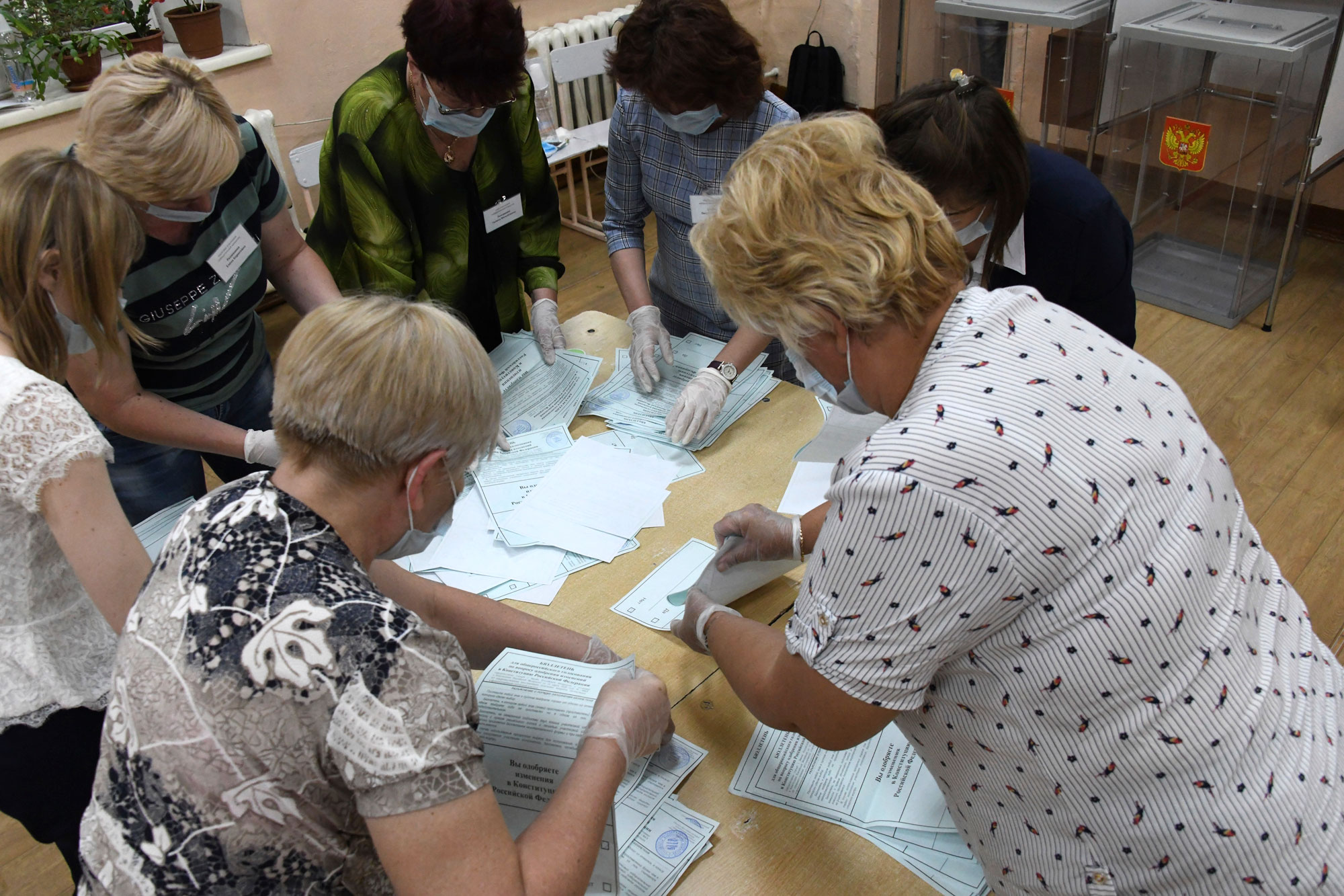 Members of an election commission count ballots after voting finished at a polling station in the eastern Siberian city of Chita, Russia, on July 1.