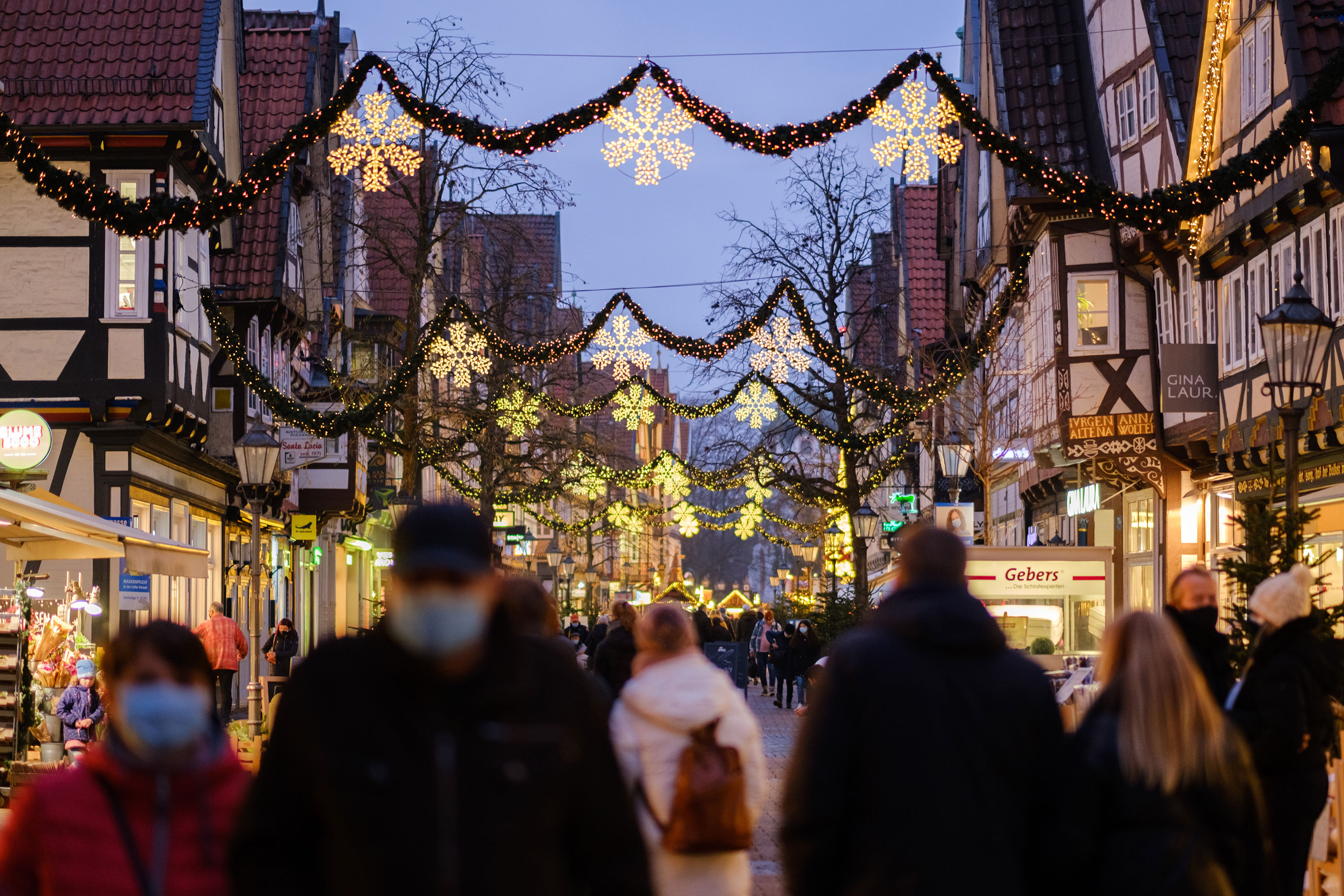 People walk through a decorated city center in Celle, Germany, on December 12.