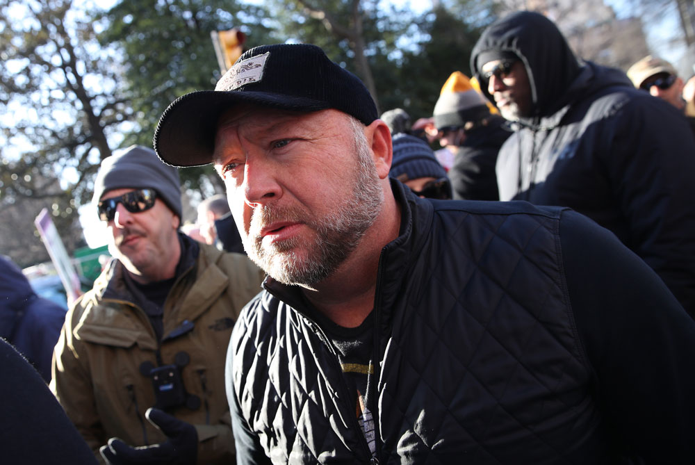 Radio show host Alex Jones joins thousands of gun rights advocates attending a rally organized by The Virginia Citizens Defense League on Capitol Square near the state capitol building January 20 in Richmond, Virginia.