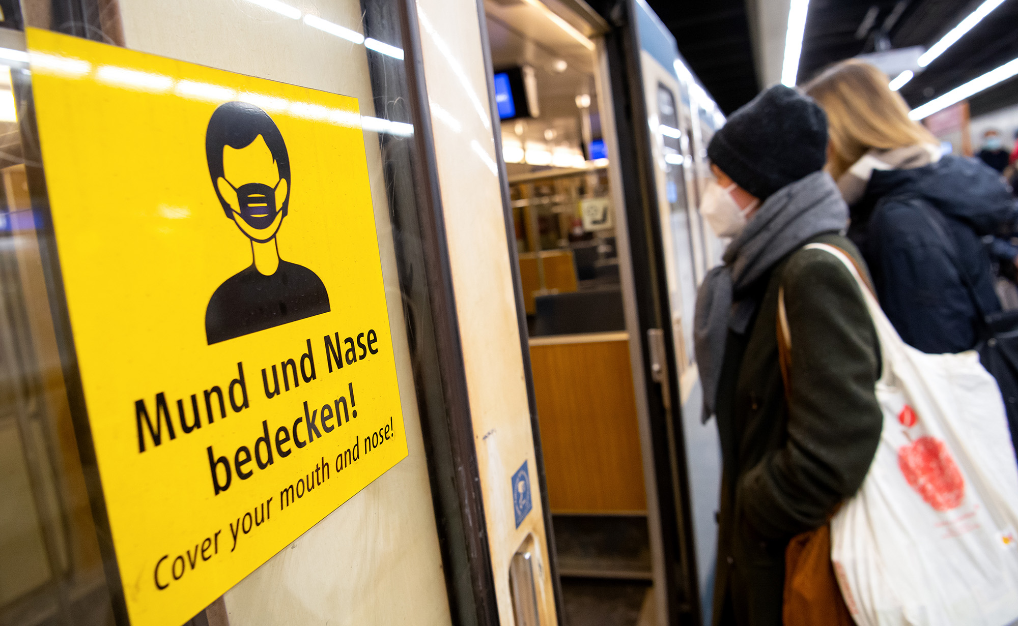 Two women wearing FFP2 masks board a train in Bavaria, on January 12, 2021.