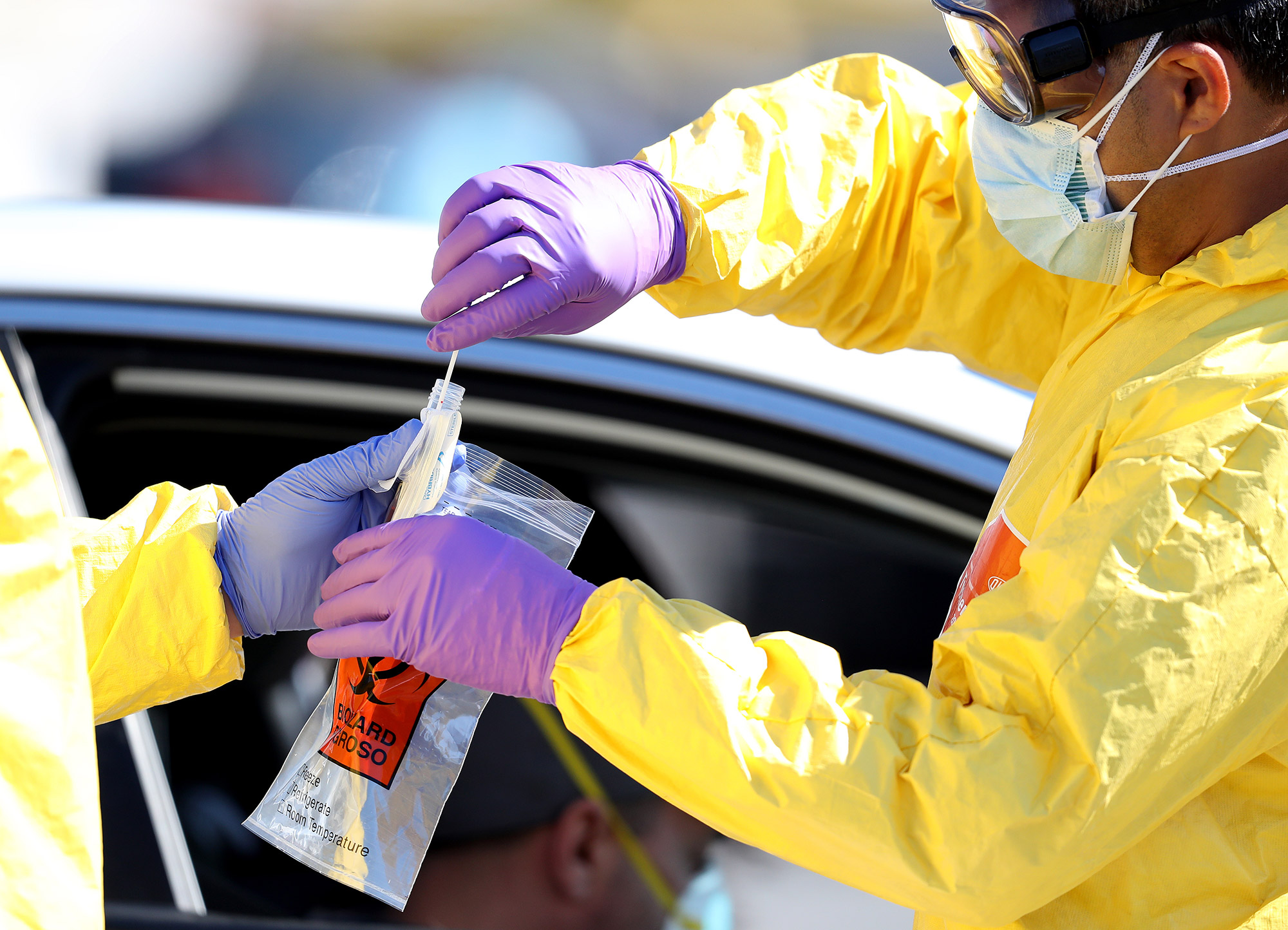 Coronavirus tests are administered at a drive-thru testing site in Jericho, New York, on April 6.