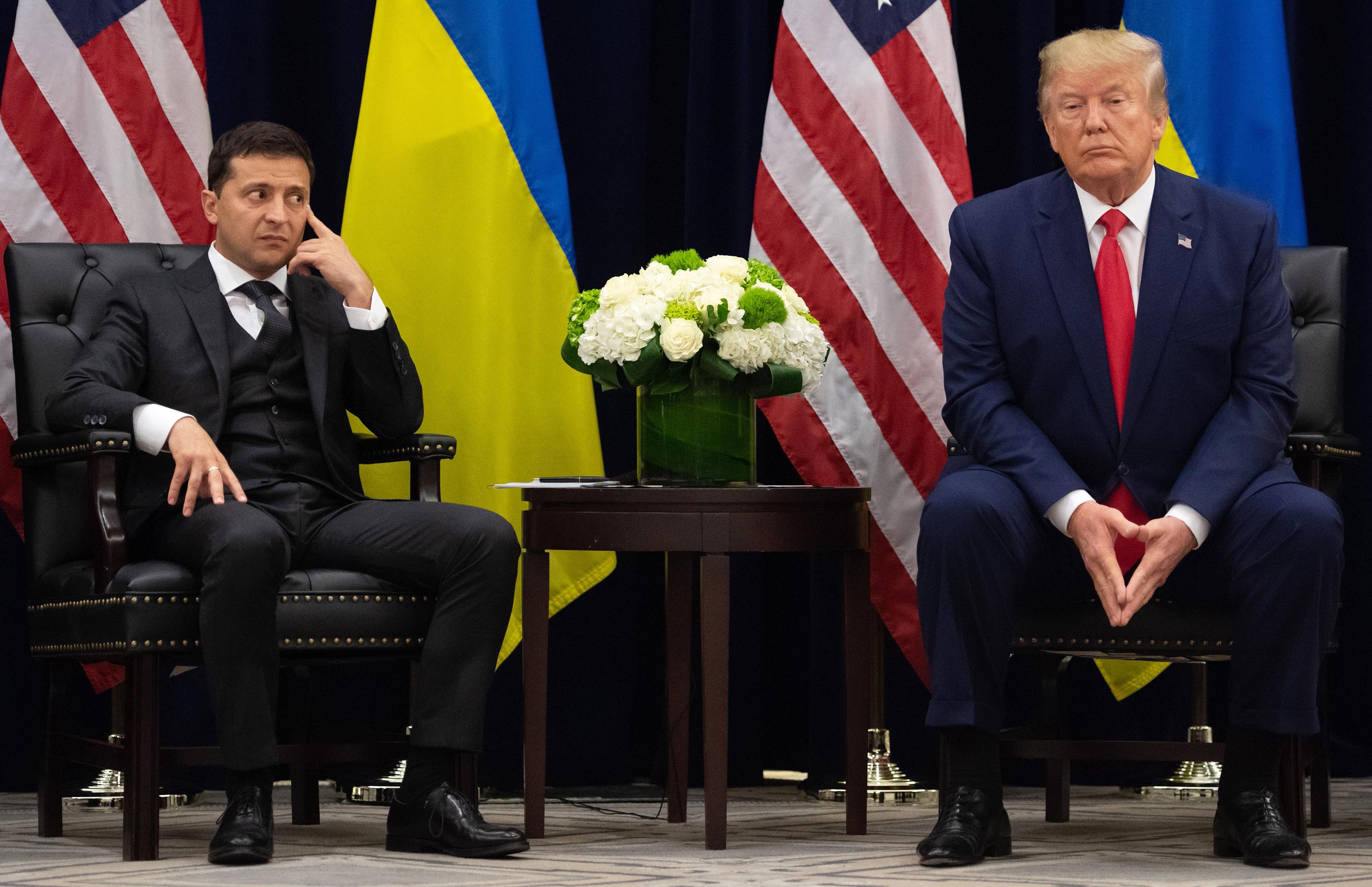 US President Donald Trump and Ukrainian President Volodymyr Zelensky looks on during a meeting in New York on September 25, 2019, on the sidelines of the United Nations General Assembly.