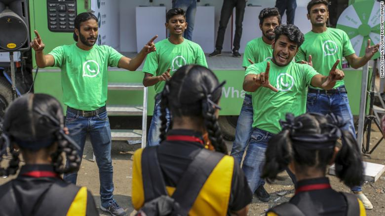WhatsApp ambassadors perform a skit during a roadshow for WhatsApp messaging service and Reliance Jio Infocomm Ltd.'s wireless network in Pune, India, on October 25, 2018.