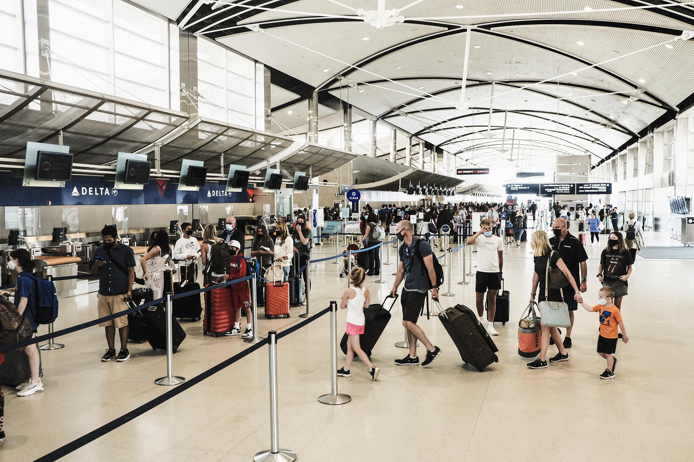 Travelers arrive at the Detroit Metropolitan Wayne County Airport in Romulus, Michigan, on Saturday, June 12.