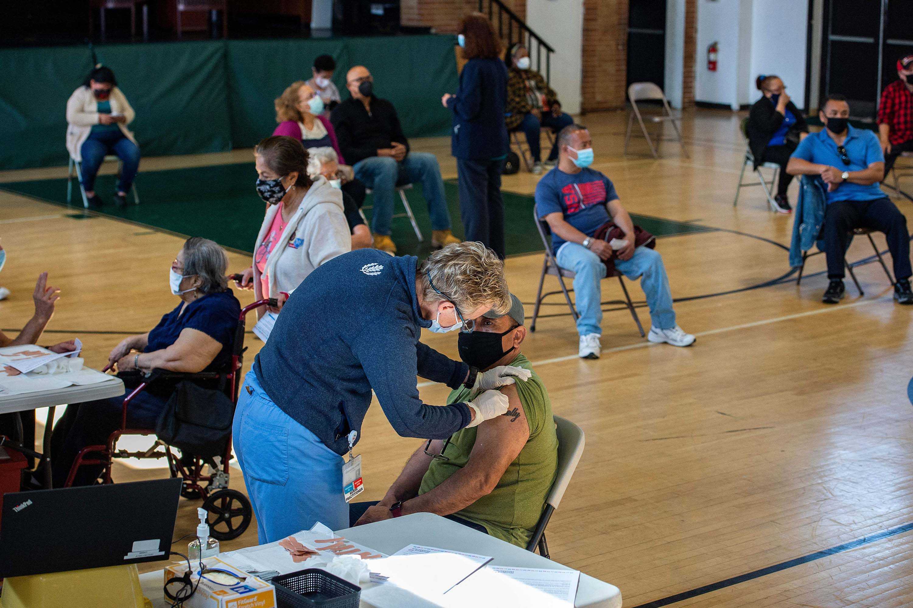 People receive the Moderna Covid-19 vaccine at a mobile vaccination clinic in Bridgeport, Connecticut on April 20.