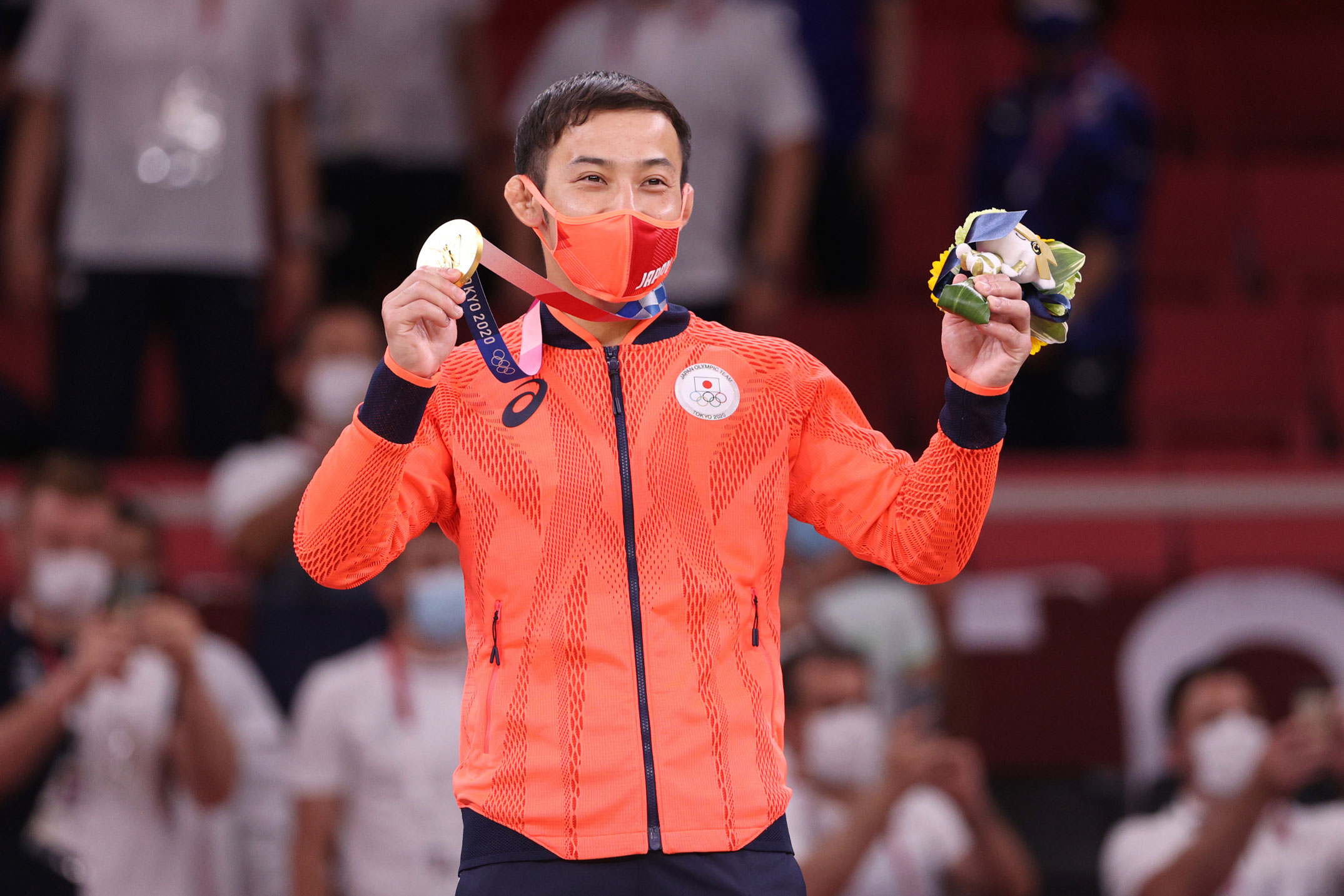Japan's Naohisa Takato poses with the gold medal for the Men's Judo 60kg Final on July 24.