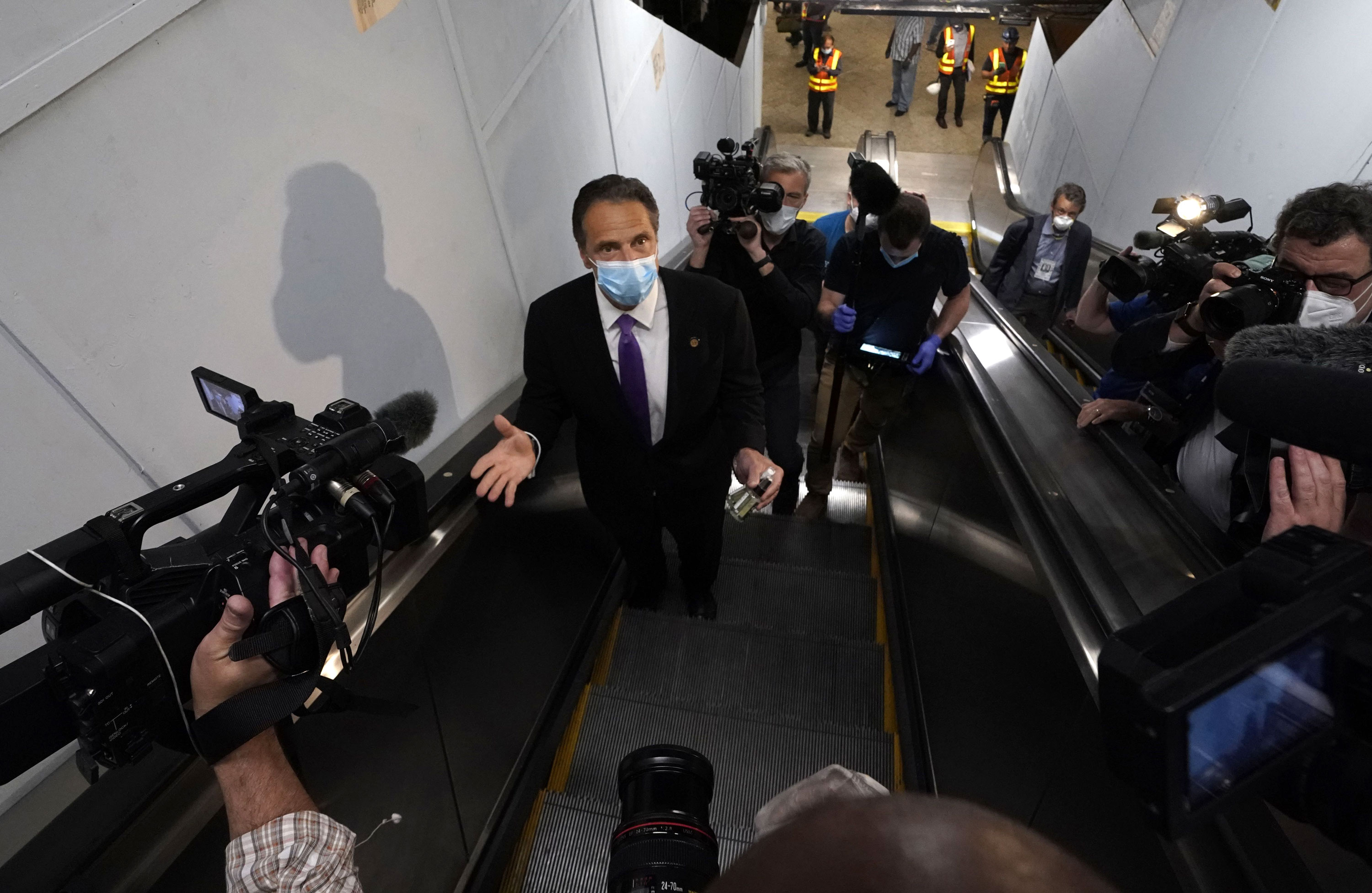 New York Governor Andrew Cuomo speaks after riding the New York City subway 7 train into the city on June 8 in New York.