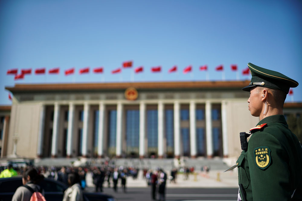 In this March 5, 2019 file photo, a Chinese paramilitary policeman stands guard at Tiananmen Square during the opening session of the National People's Congress in Beijing, China.