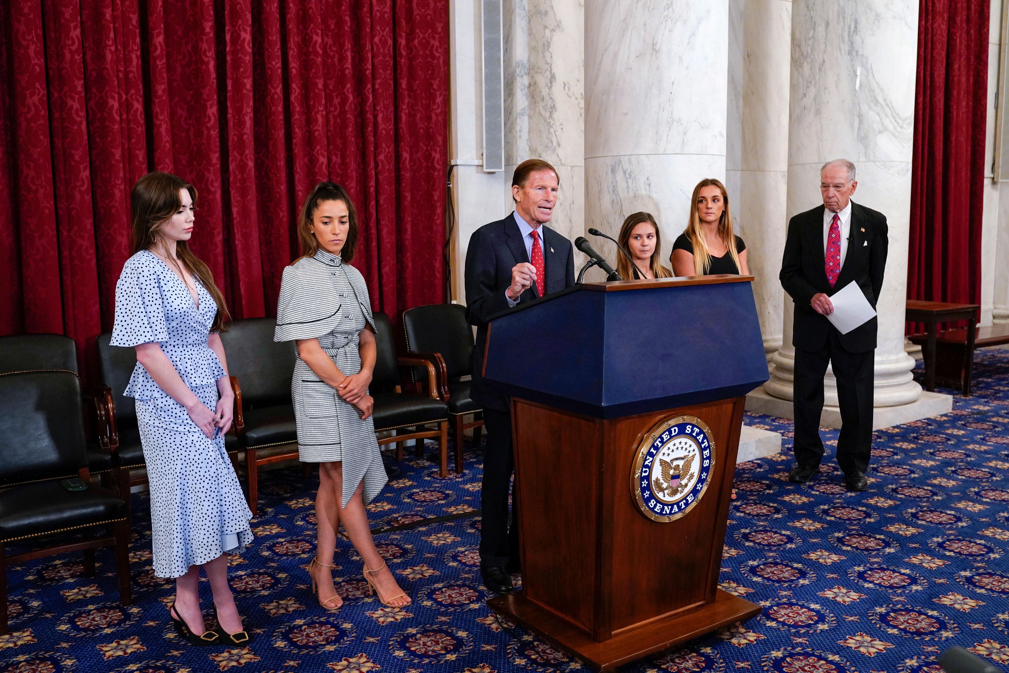 Sen. Richard Blumenthal, center, speaks at a news conference in Washington, DC, on September 15.