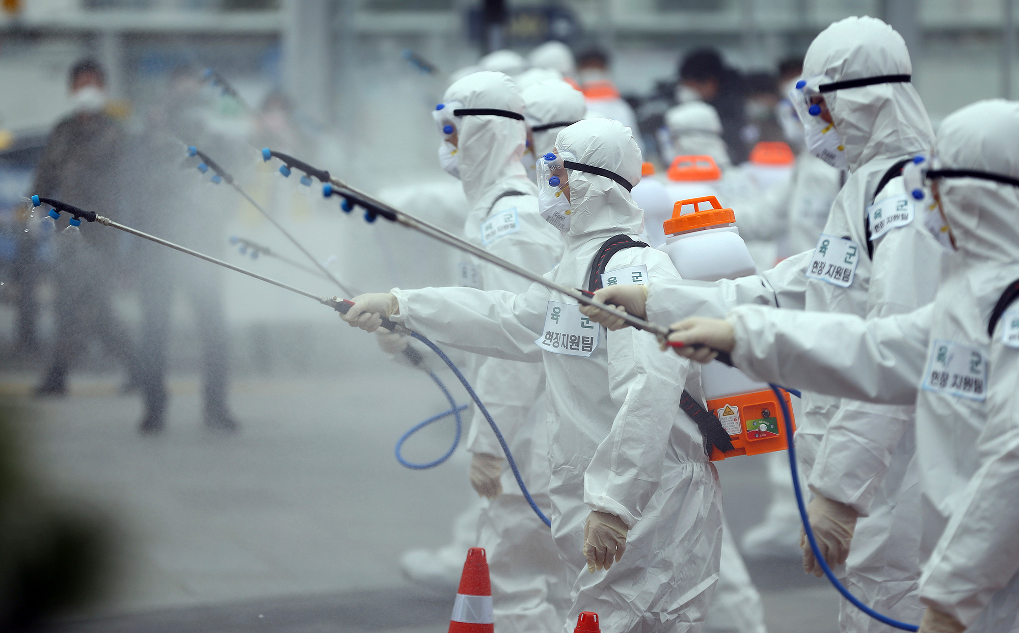 Army soldiers wearing protective suits spray disinfectant to prevent the spread of the new coronavirus at the Dongdaegu train station in Daegu, South Korea, Saturday, February 29.
