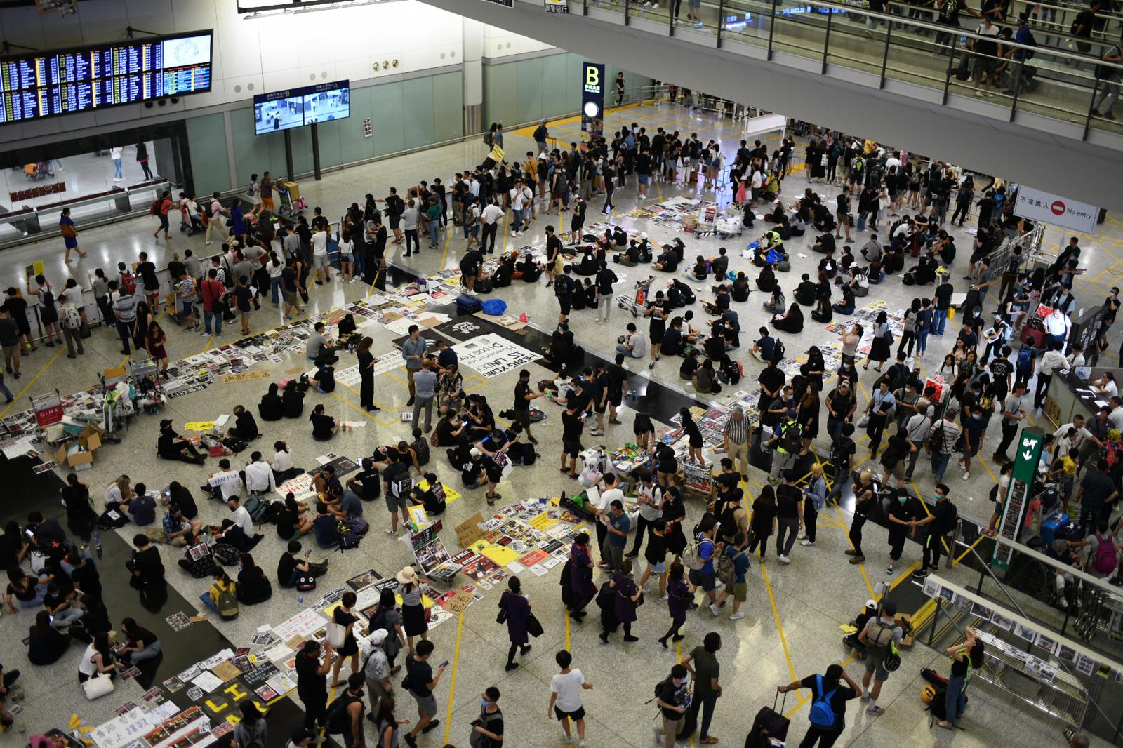 Protesters occupy Hong Kong airport arrivals hall on August 13, 2019.