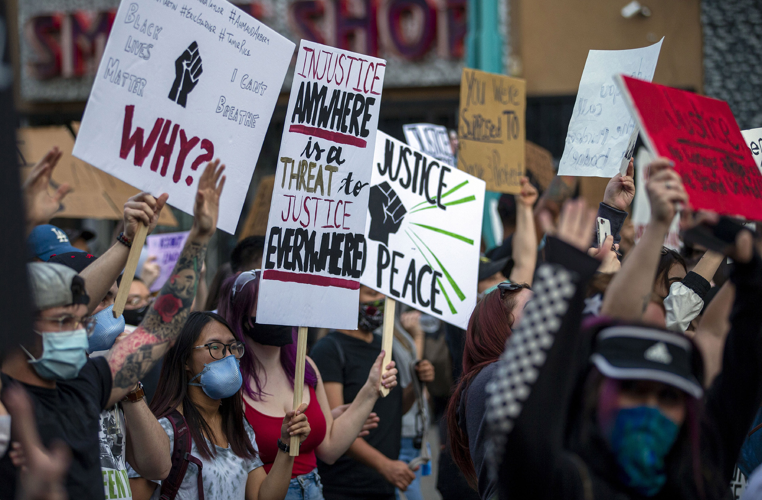 Demonstrators protest the death of George Floyd in downtown Albuquerque, New Mexico, on Sunday, May 31.